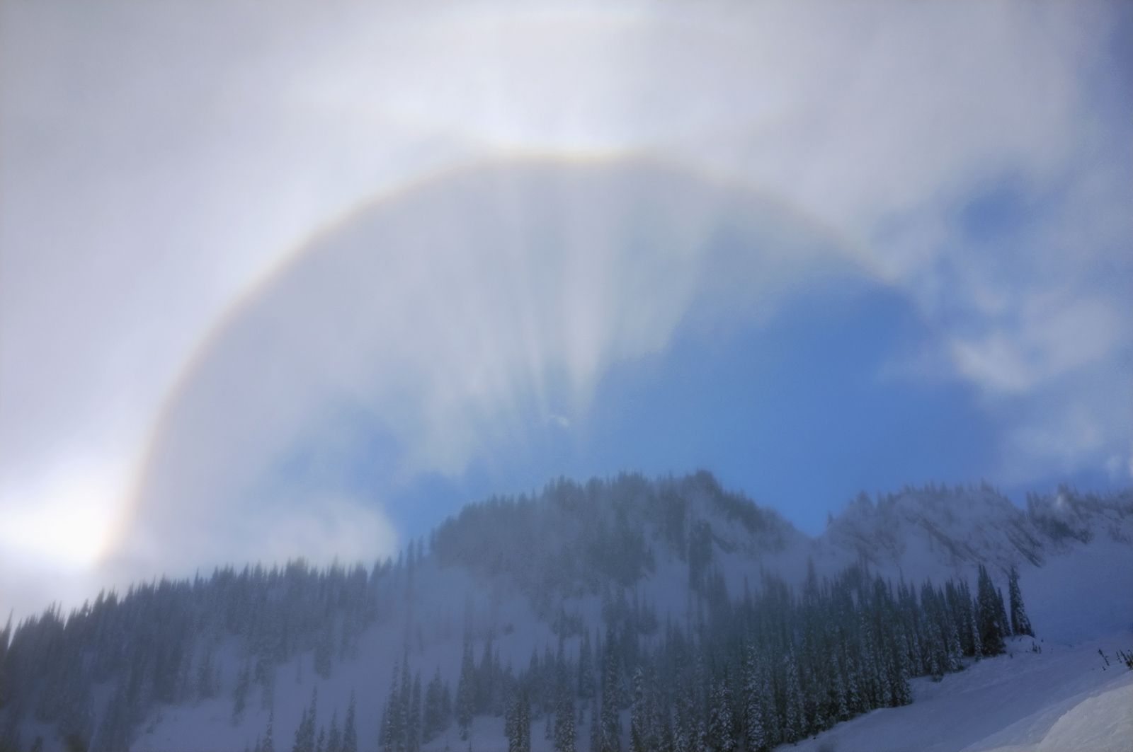 While out on a ski trip in Canada I was amazed to see this gorgeous corona forming over the crest of the tree topped mountains...