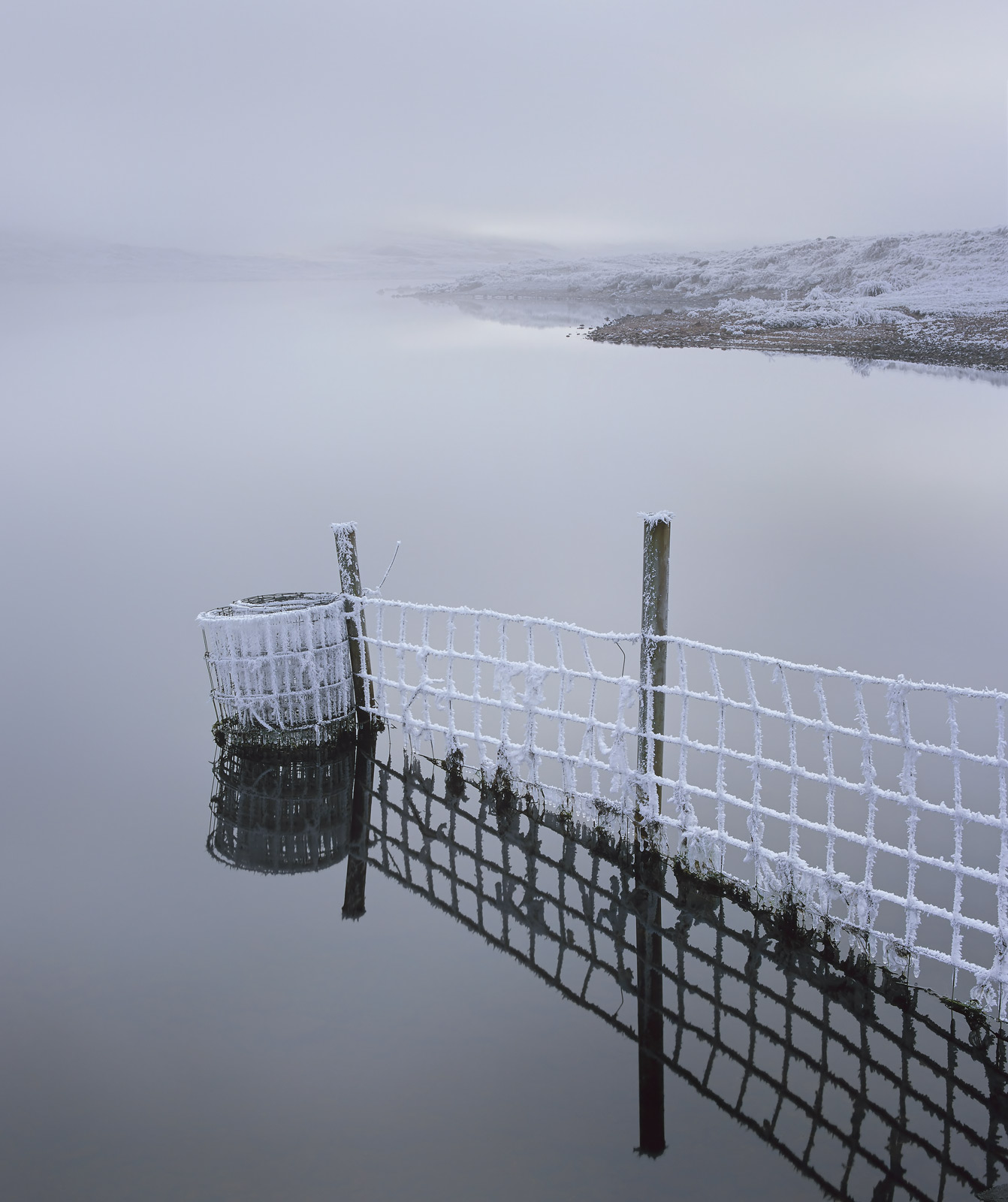 Extreme low temperatures from freezing mist clearing over Loch A Chroisg near Achnasheen began to slowly dissipate leaving a...