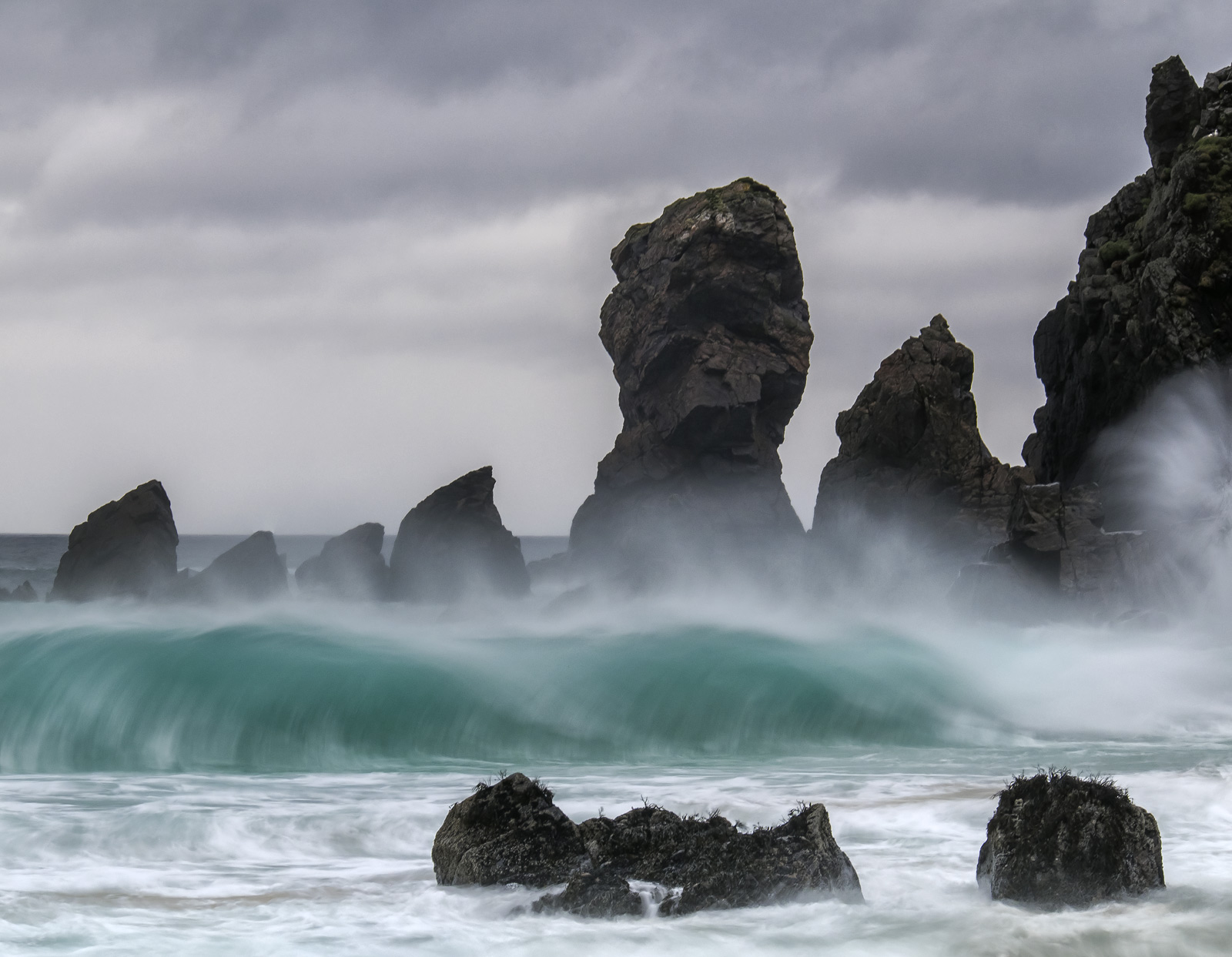Towering waves of turquoise water crashed onto Dail Mhor beach and those rock stacks at the end of the sandy bay. The colour...