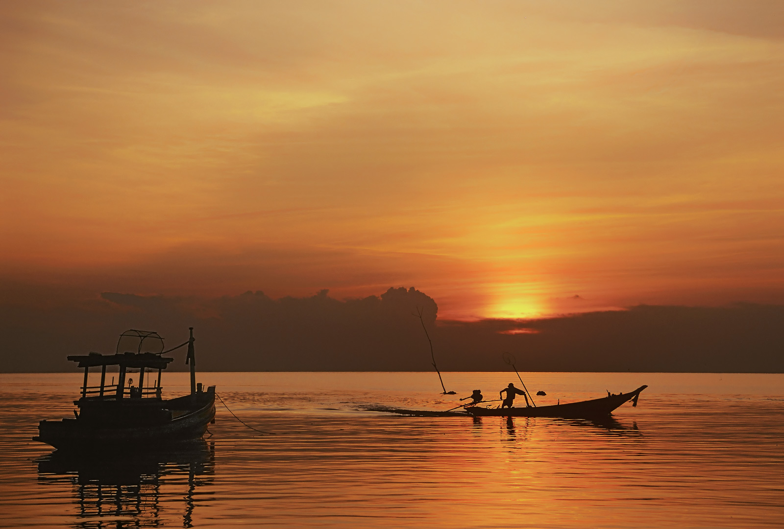 Days end in Thailand off Pra Ngan beach, Krabiand the fishermen race for home with their long prop boats. I timed...