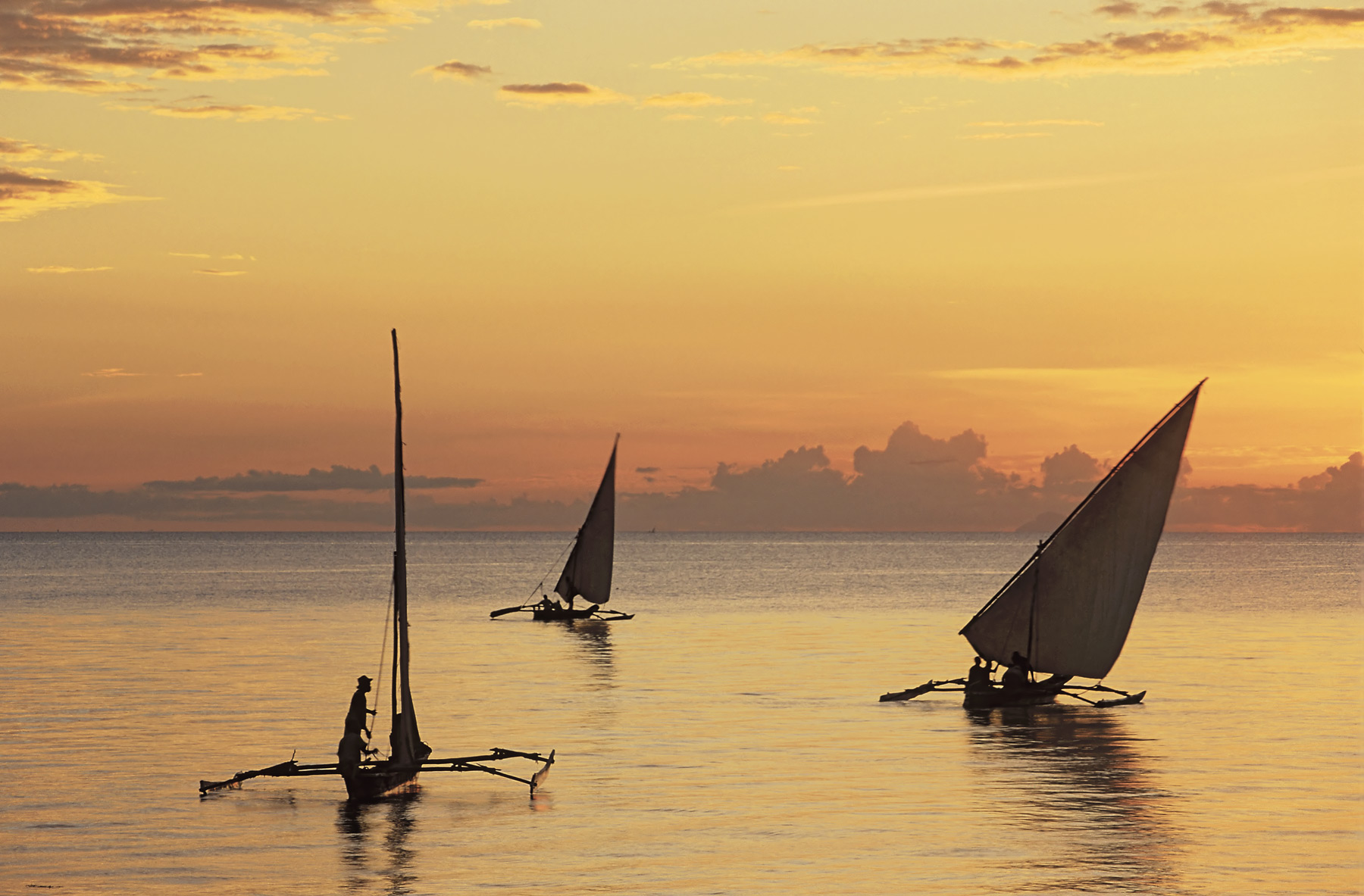 A glorious sight sailing dhows drifting into the most sumptuous dawn light eventually formed a triangular shape not dissimilar...