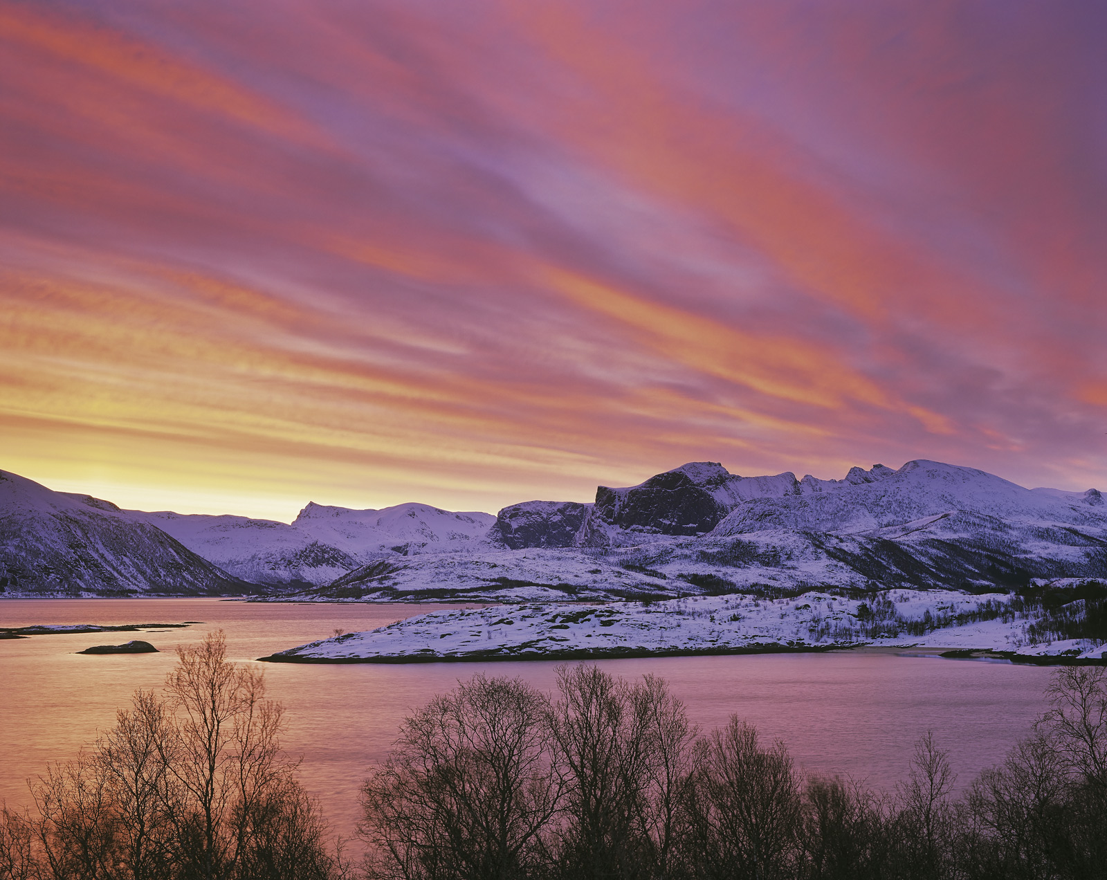 I hope that this picture looks just as it was, a very beautiful winter sunrise over the mountains of Senja. In truth I...
