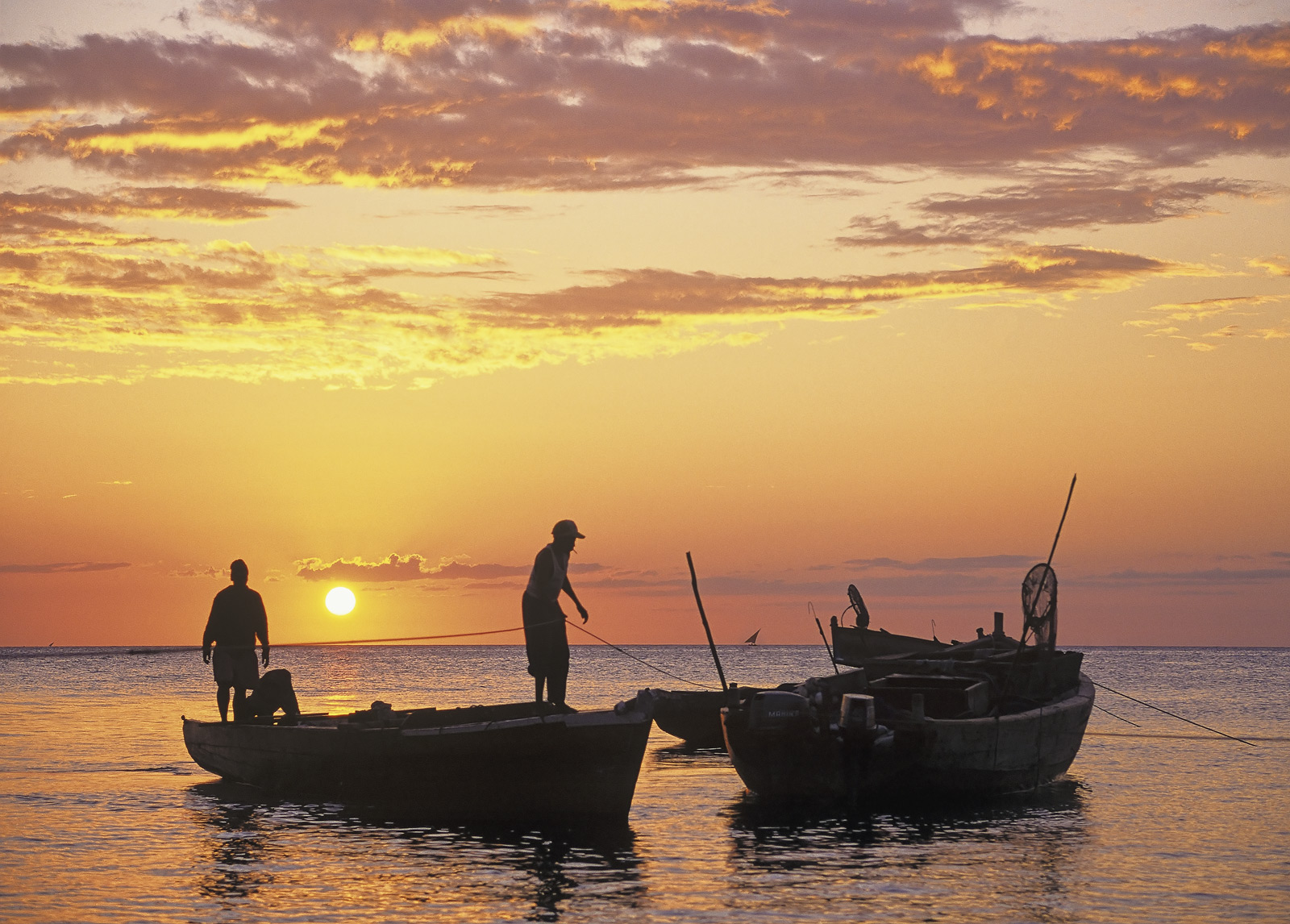 As the sun slowly sinks on the west coast of Zanzibar the fishermen busy themselves in preparation for night fishing where they...