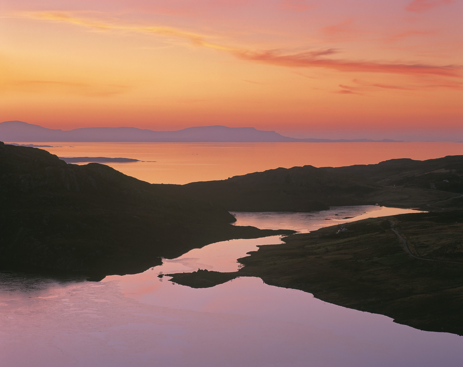 A glorious sunset slowly blossomed from the high viewpoint over Diabaig, the little cloud that was present lit up and turned...