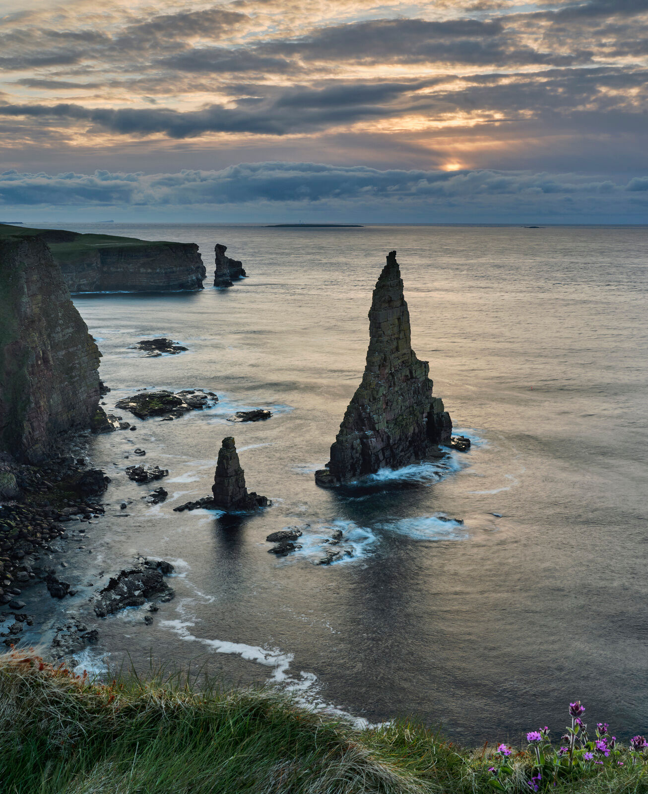 A clifftop view of the rock stacks at Duncansby Head a short time after a Spring sunrise in Caithness.