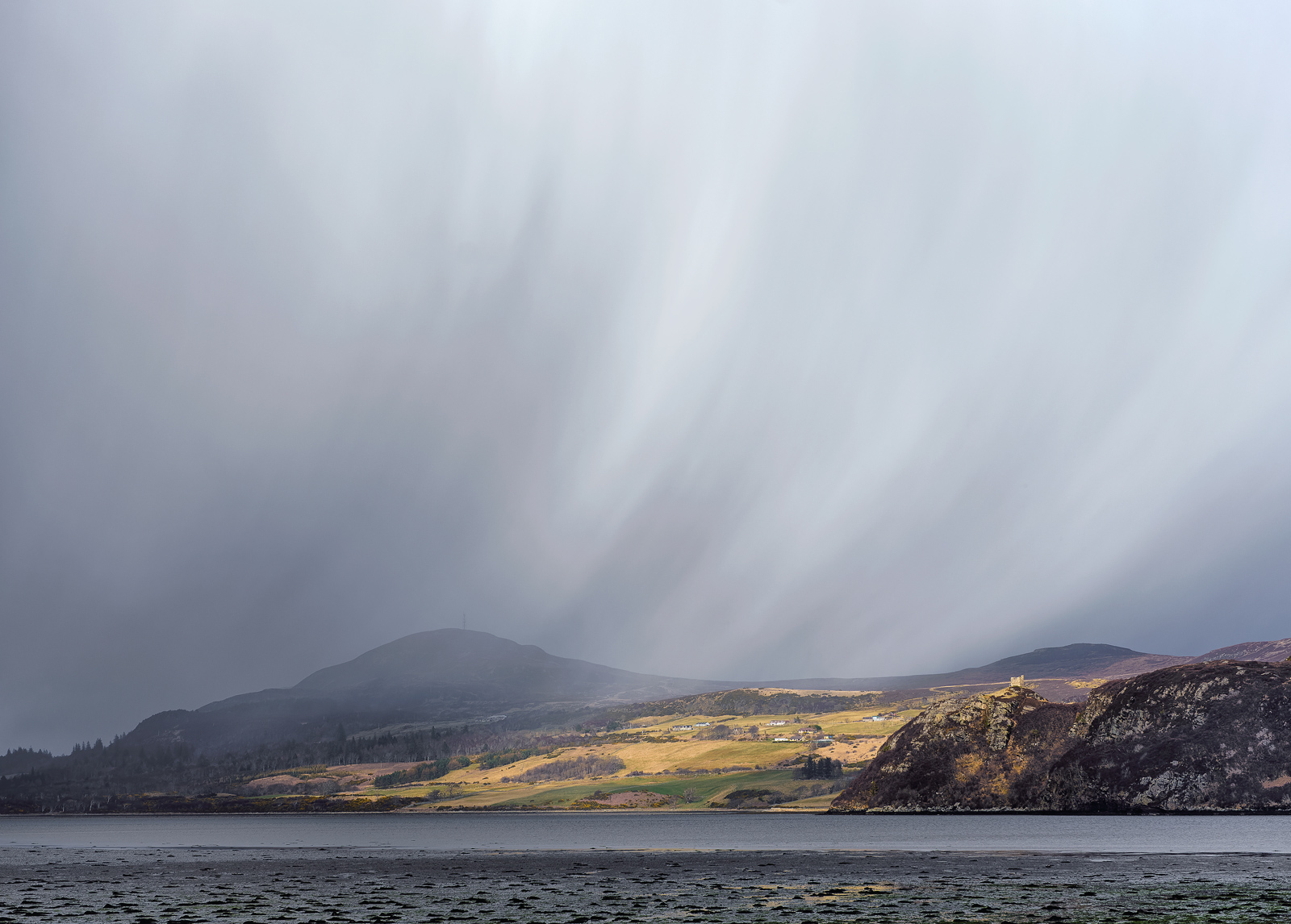 windblown hail and snow over Varrich Castle near Tongue.