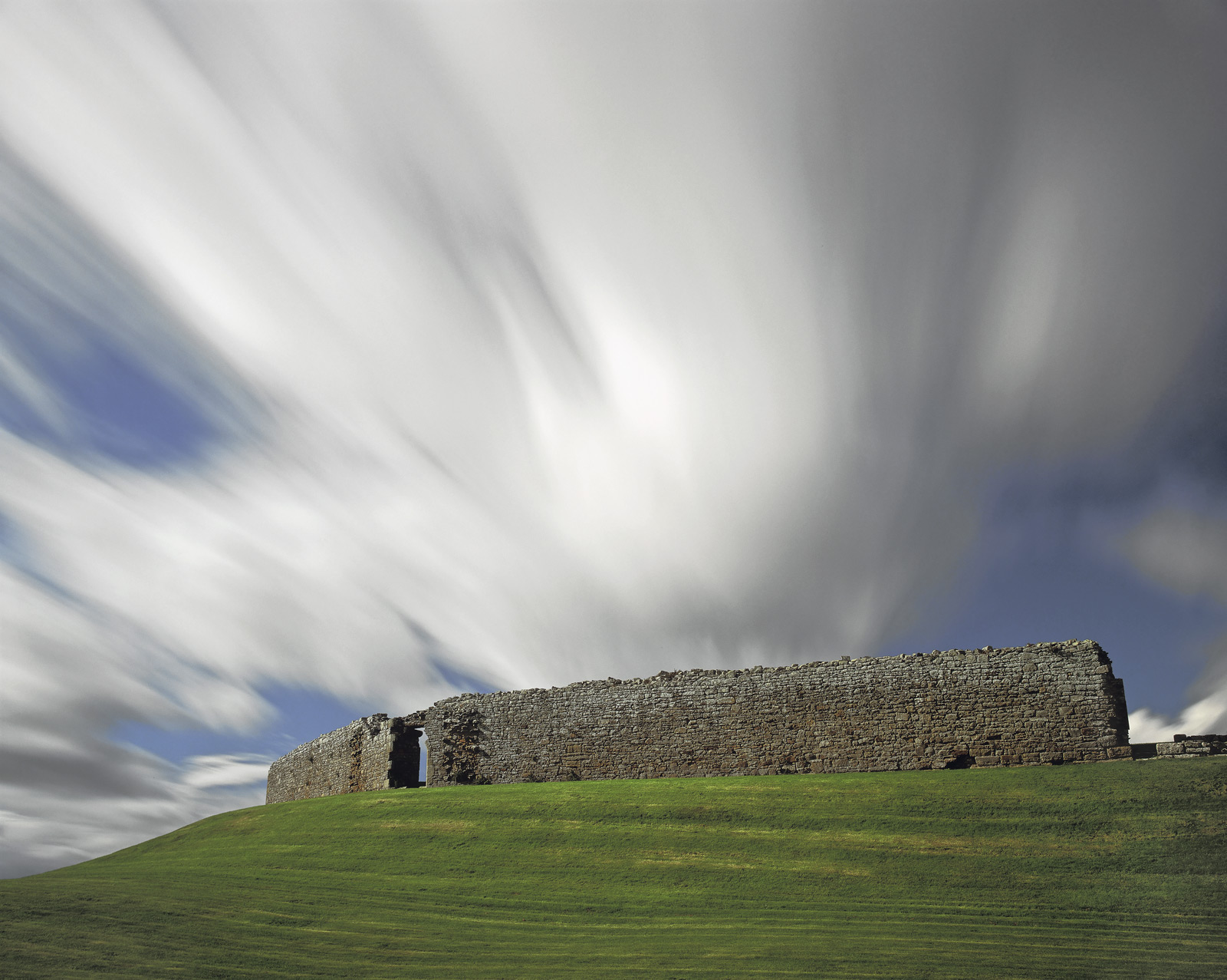 A fine breezy summer day at Duffus castle saw large white cumulus clouds scudding towards us over a sunlit castle wall mimicing...