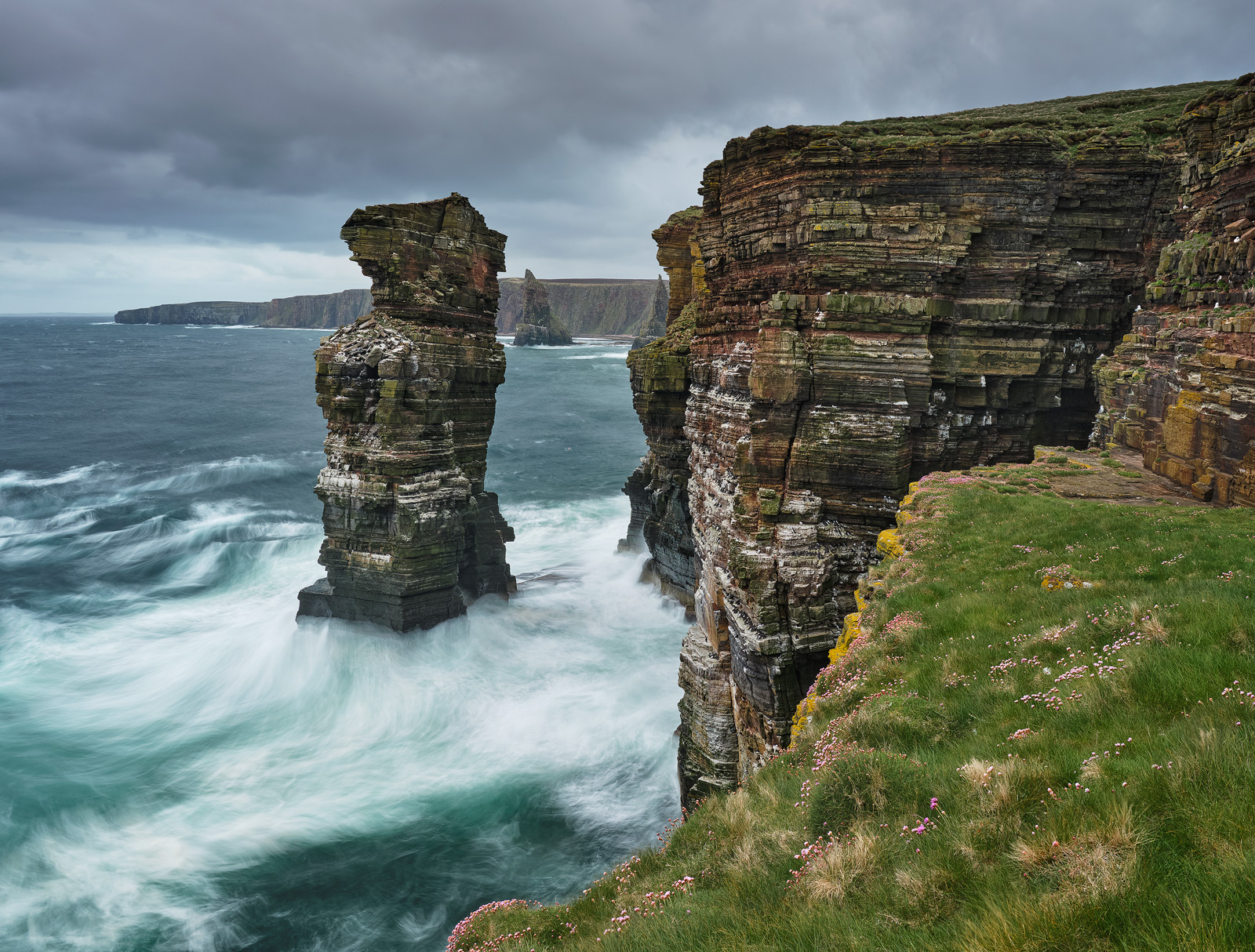 Colossal turquoise waves rolled in and slapped the flanks of the cliffs and sea stack at Duncansby on the Caithness coast.