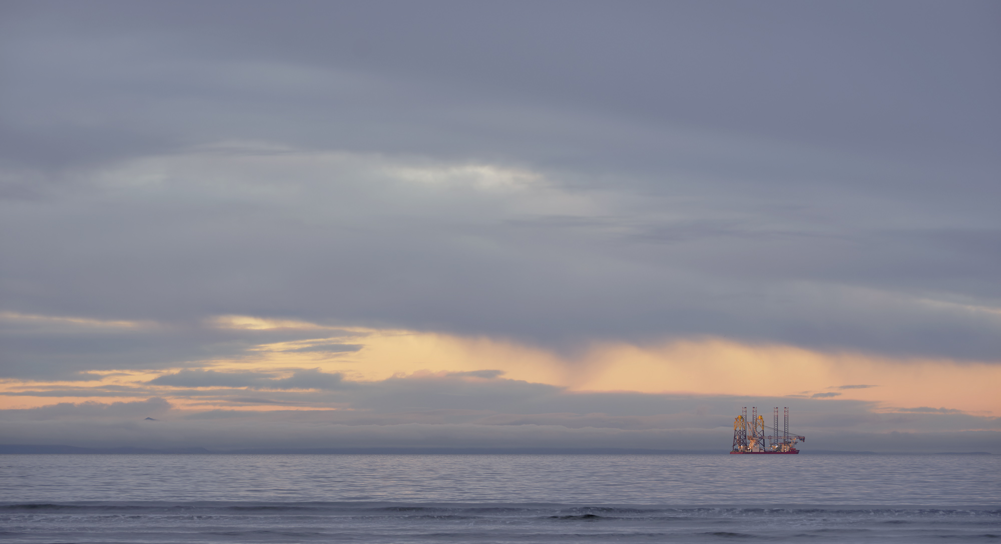As the sun dipped below the horizon the last dregs of low angled light glanced the tallest object out on the Moray Firth which...