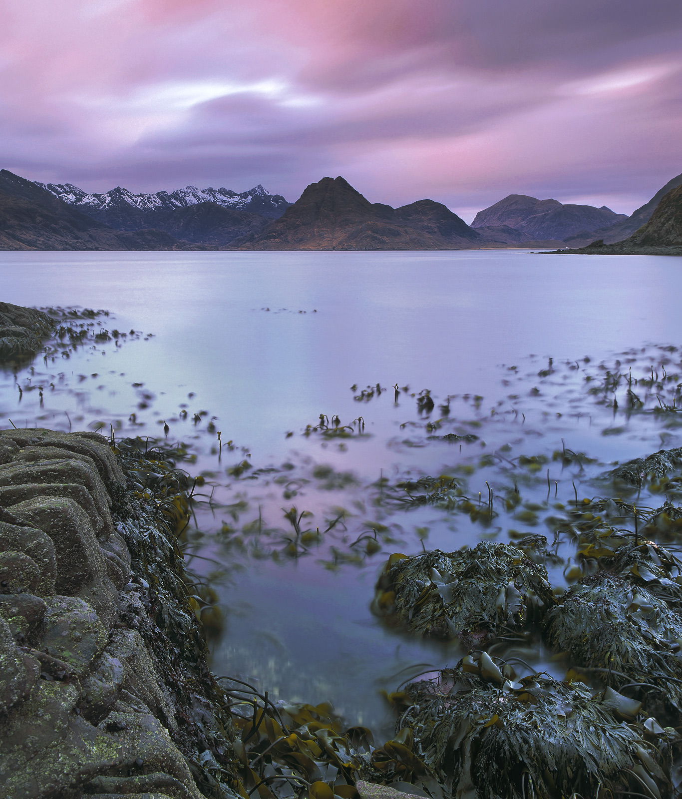 The sensuous colours of twilight rolled overhead above an an extremely low tide at Elgol, so low in fact that even the kelp beds...