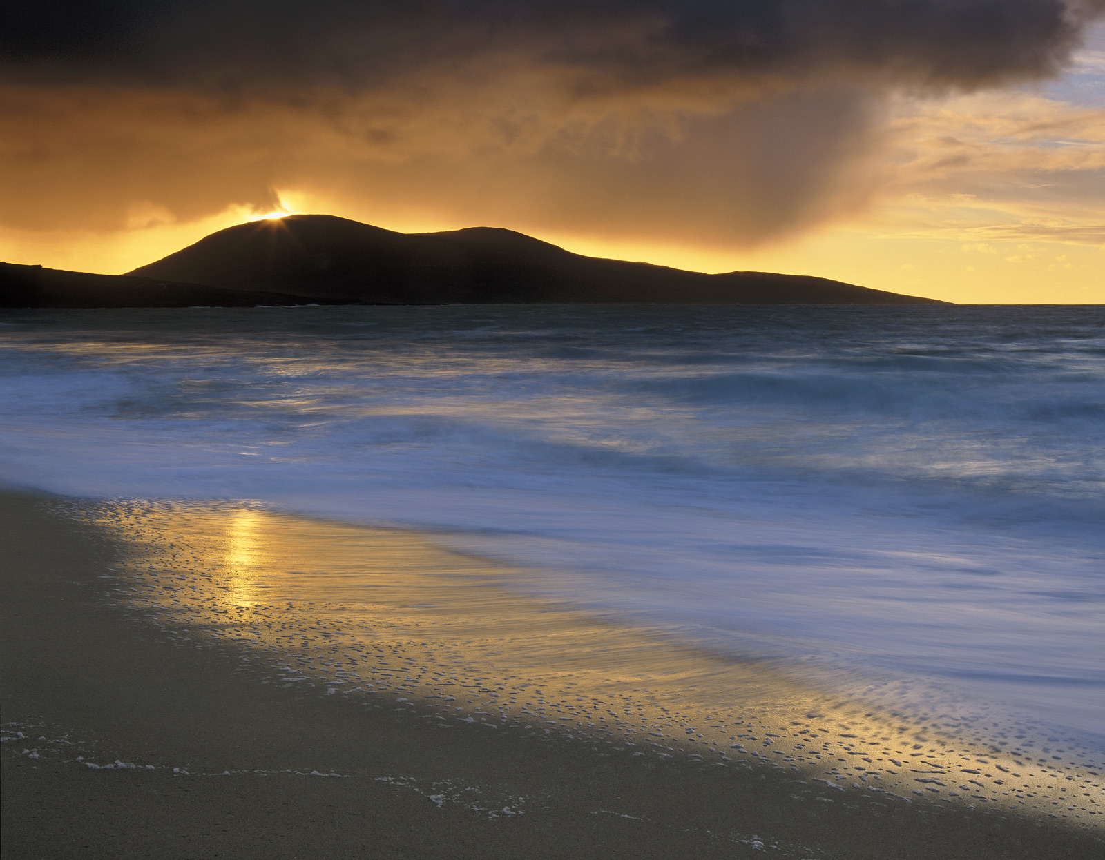 Standing on this most beautiful of Harris beaches with the wind screaming past my ears and huge waves pounding the shore was...
