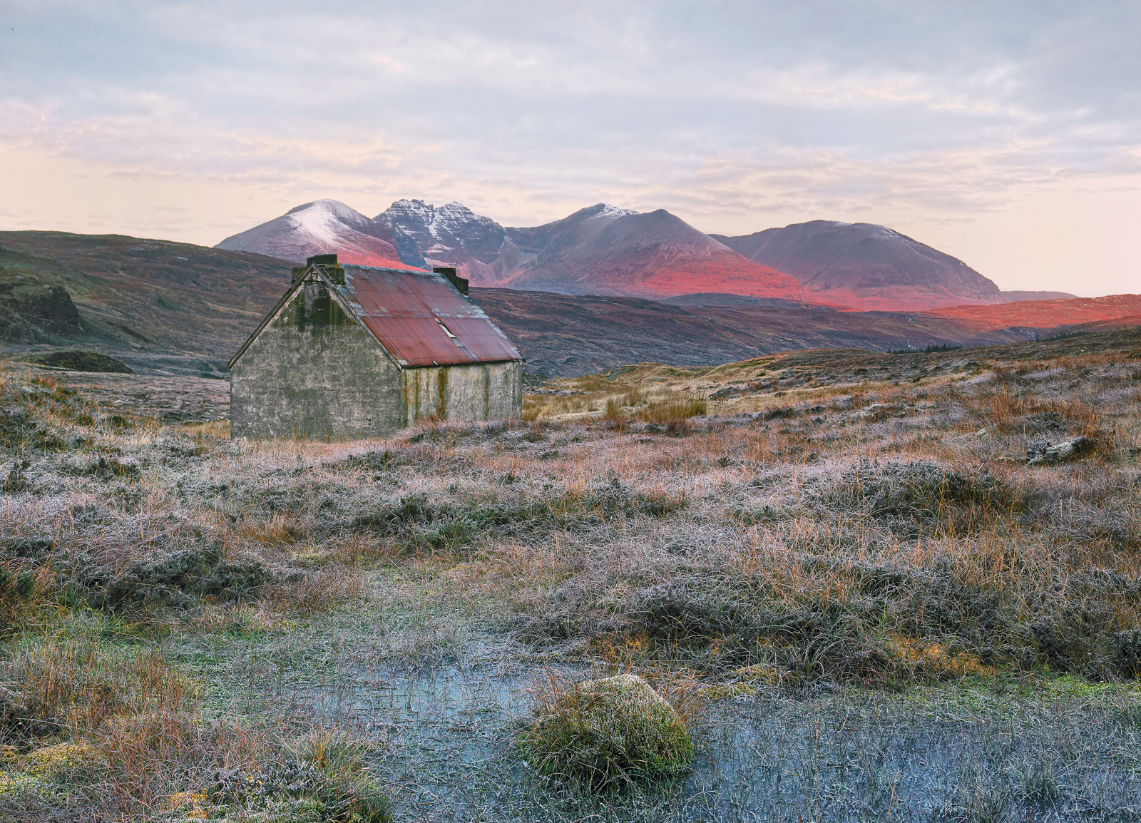 I gambled that it would be a frosty sunrise with the first light of morning striking the distant peaks of An Teallach and the...