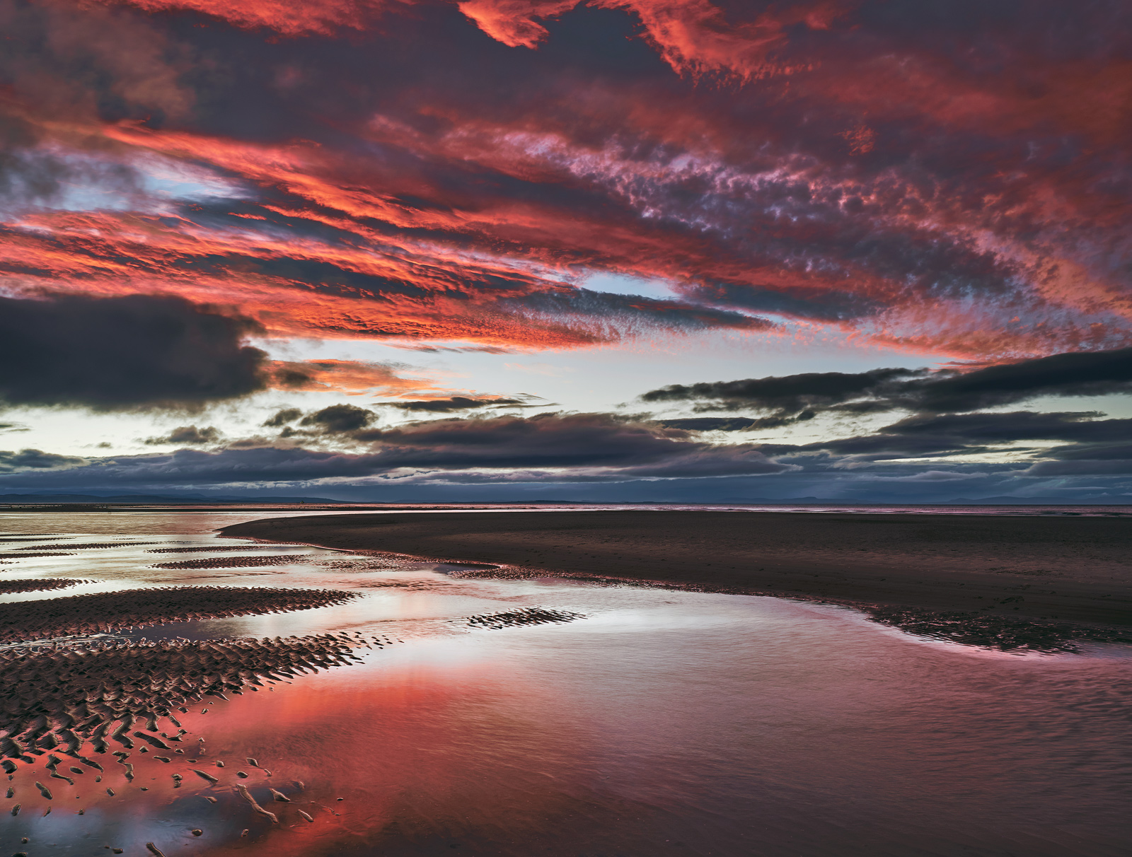 Nearly a half hour after sunset and the colours are still going strong, the sky still has strips of crimson striating it but...