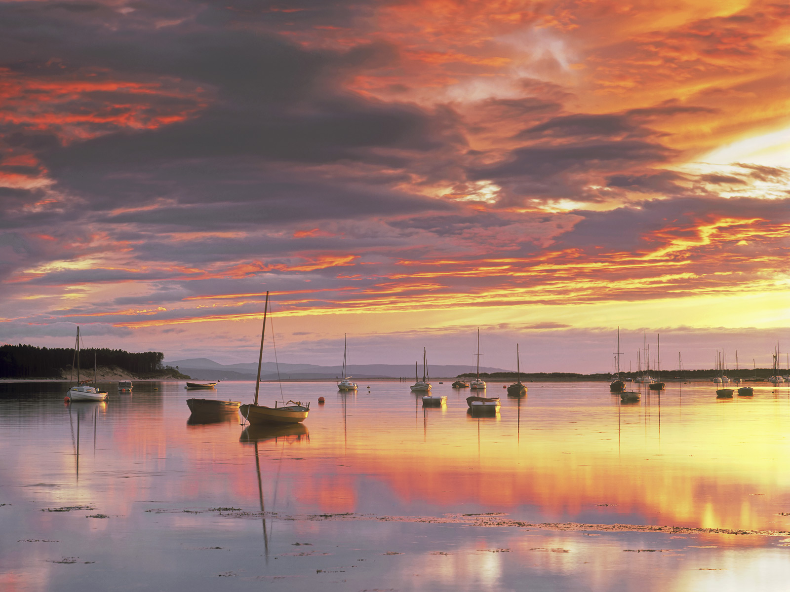 A breathtakingly vibrant mid-summer sunset overFindhorn bay lit up a vast expanse of sky. Combined with a breathlessly...