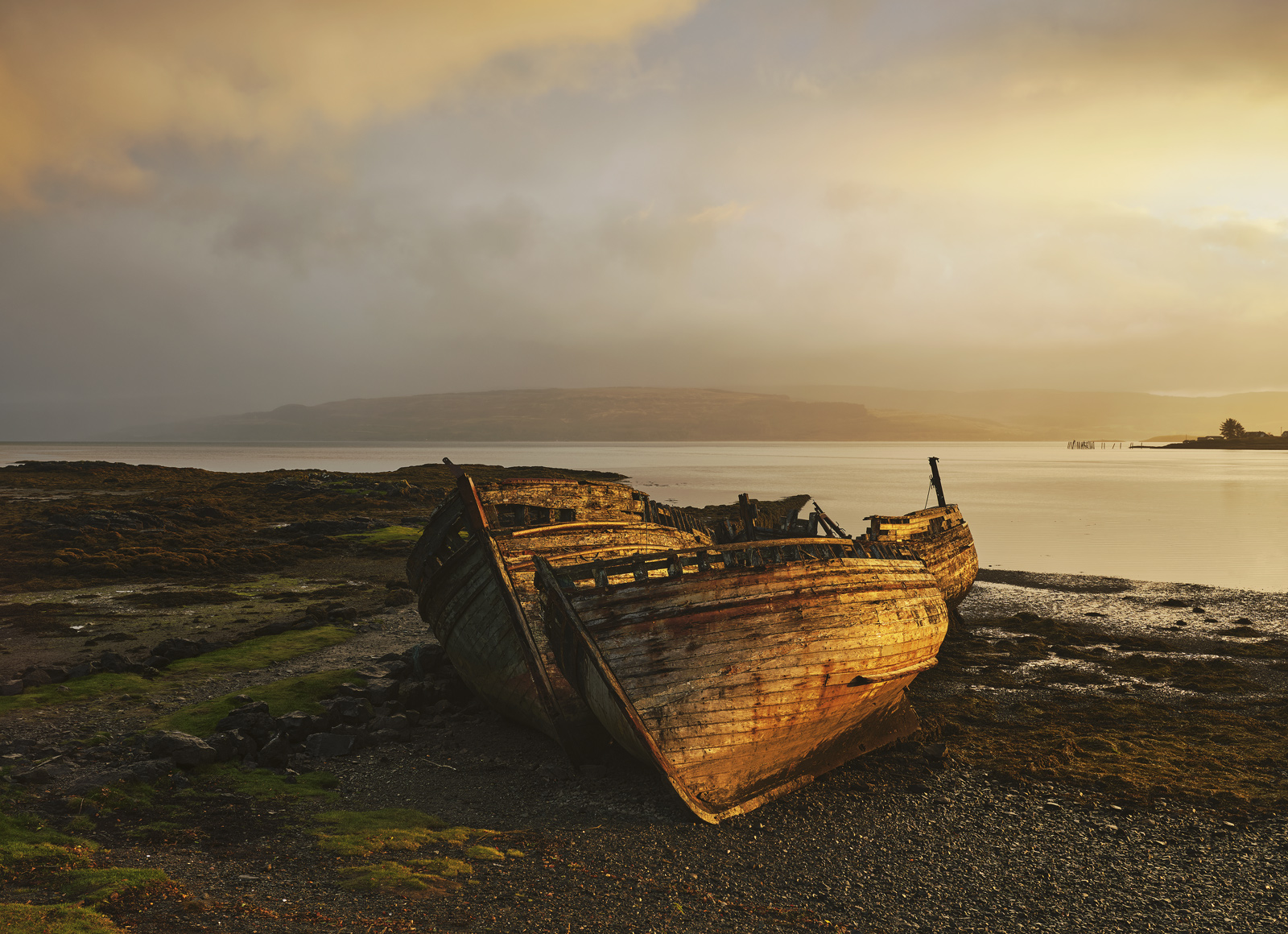 These old boats decrepit and decaying have been hauled up on the beach at Salen for years and photographed countless times....