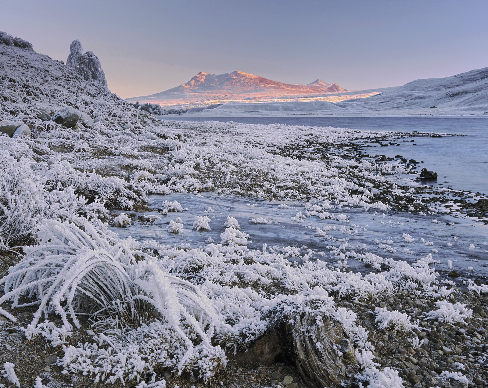 It was a ridiculously cold dry morning by the edge of Loch a Chroisg near Achnasheen. A stream had turned to solid ice...