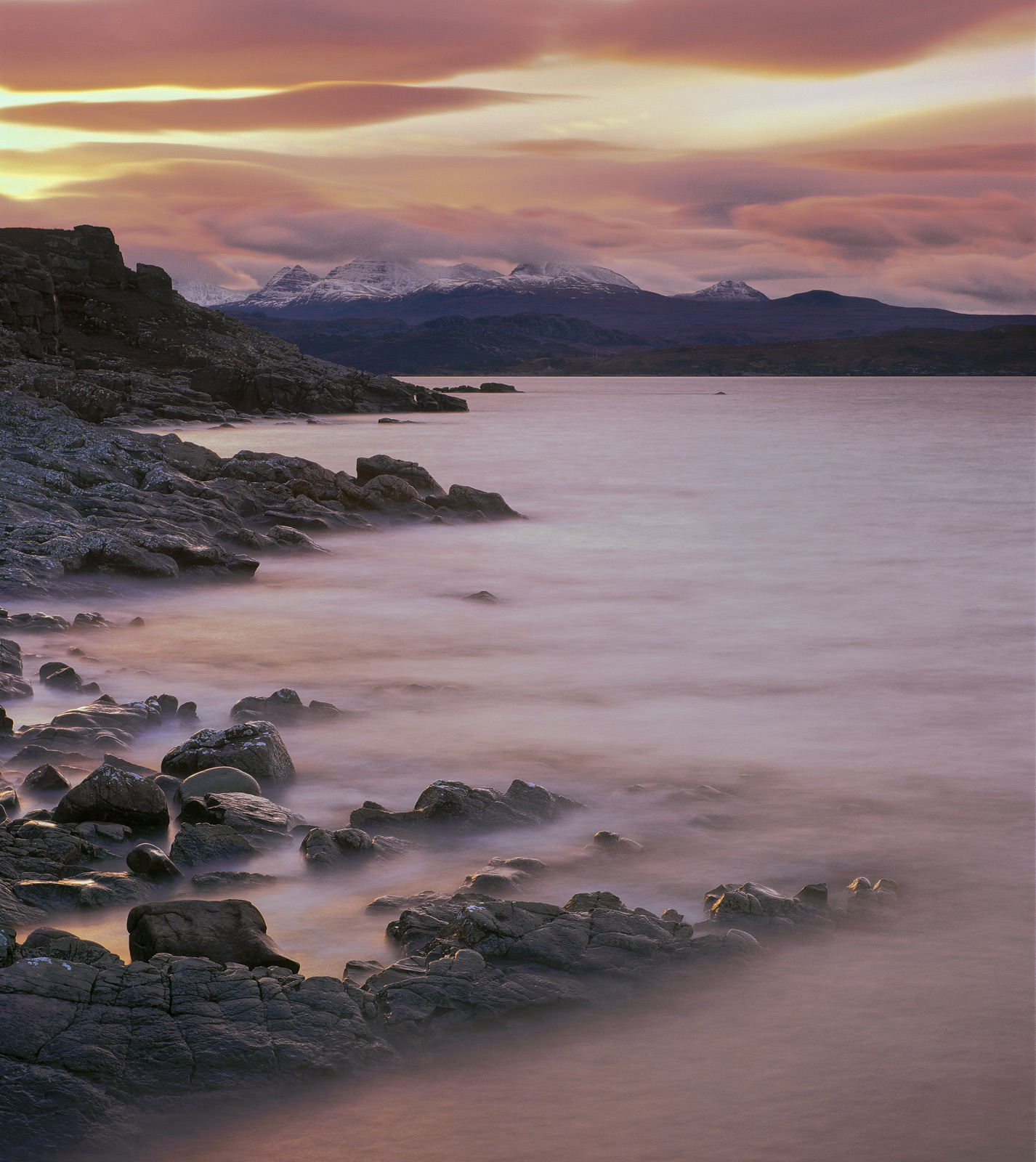 The spur of land that leads up to the old lighthouse at gairloch can give some very beautiful views back towards the mountains...