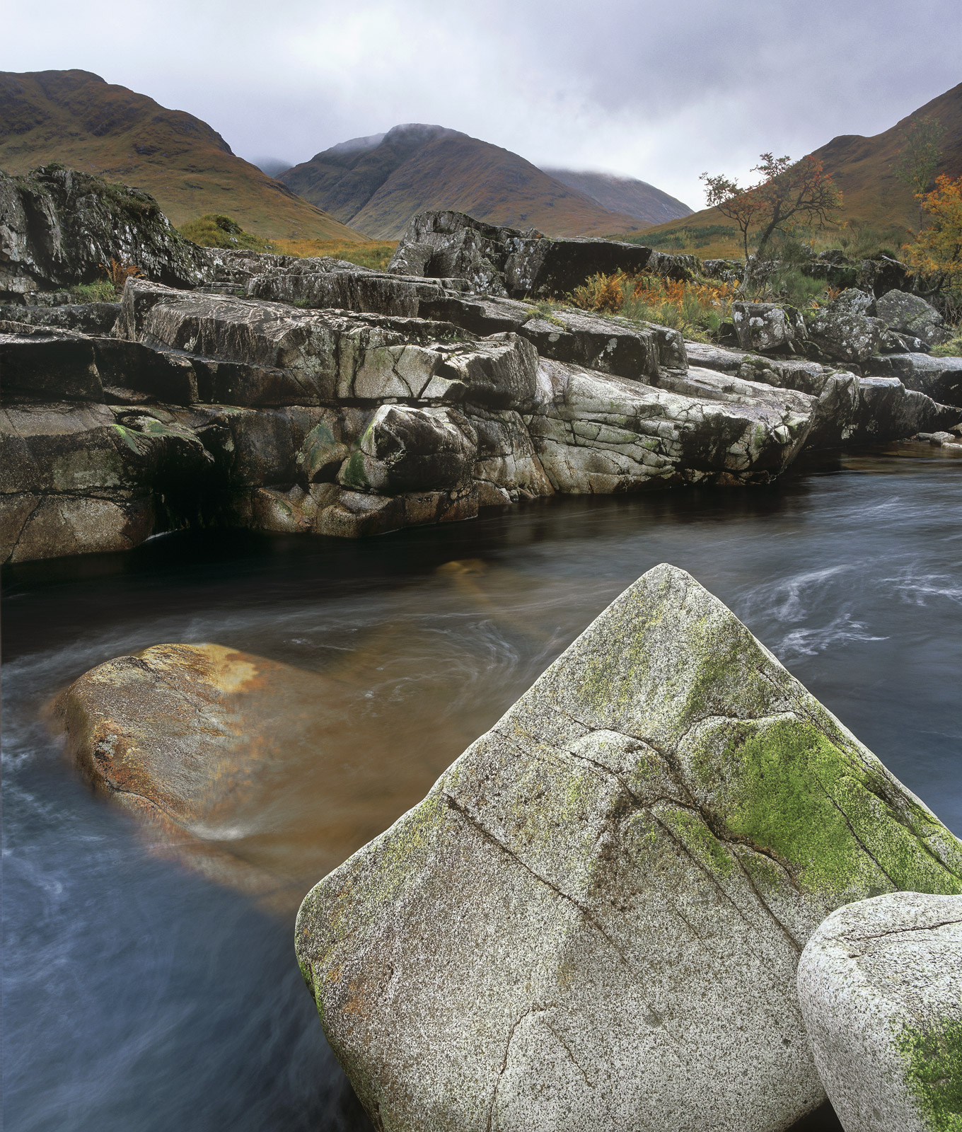 Glen Etive is filled with tumbling waterfalls and water carved rock but this section has some wonderful geometric shapes which...