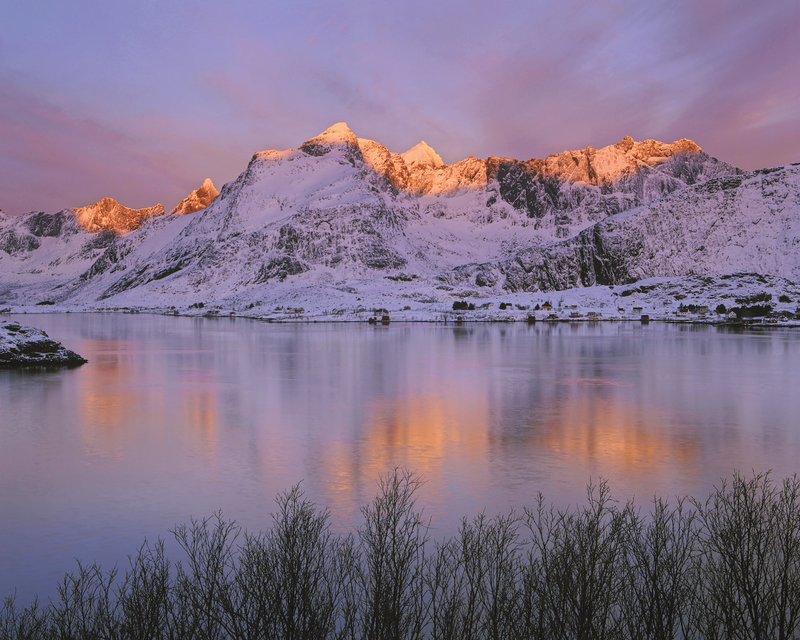An exquisitely beautiful winter sunrise painted the tops of Selfjord's impressive mountains ginger shortly after sunrise.&nbsp...