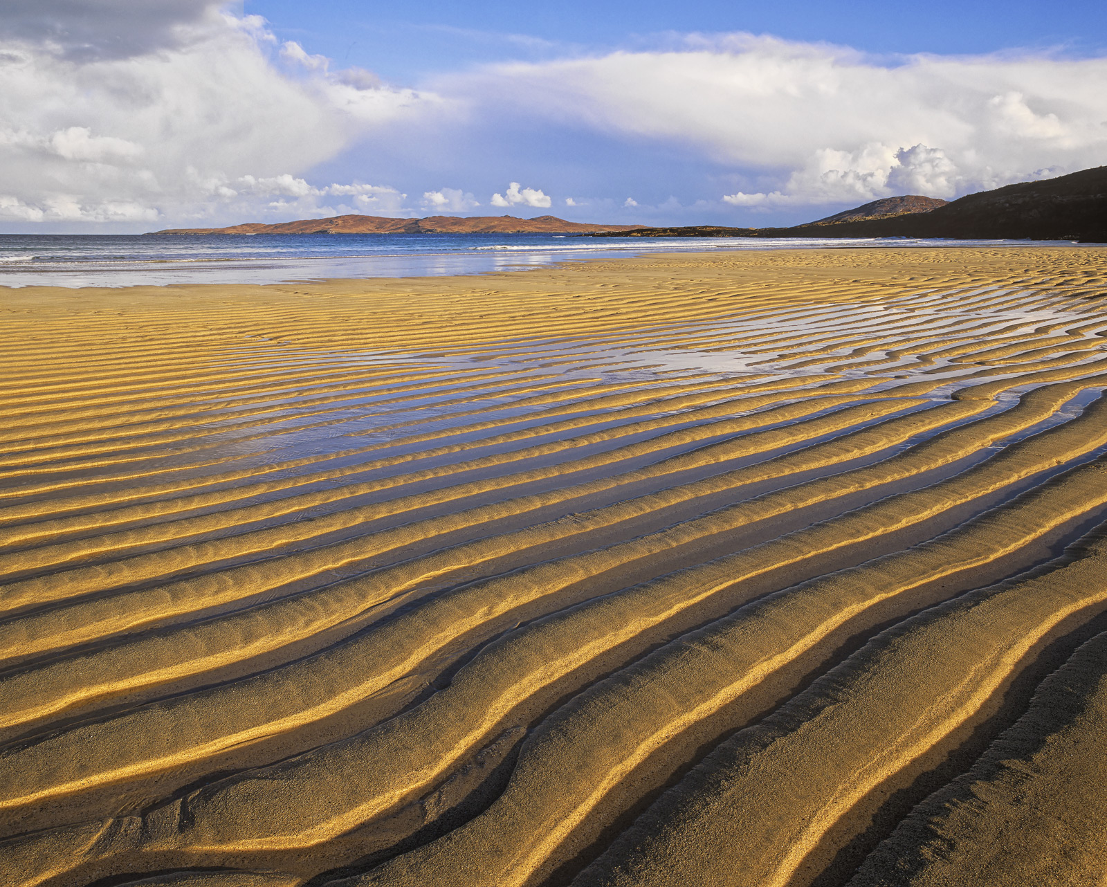 There are dozens of extraordinarily beautiful sandy beaches on Harris but few of them beat Traigh Lar after a decent swell at...