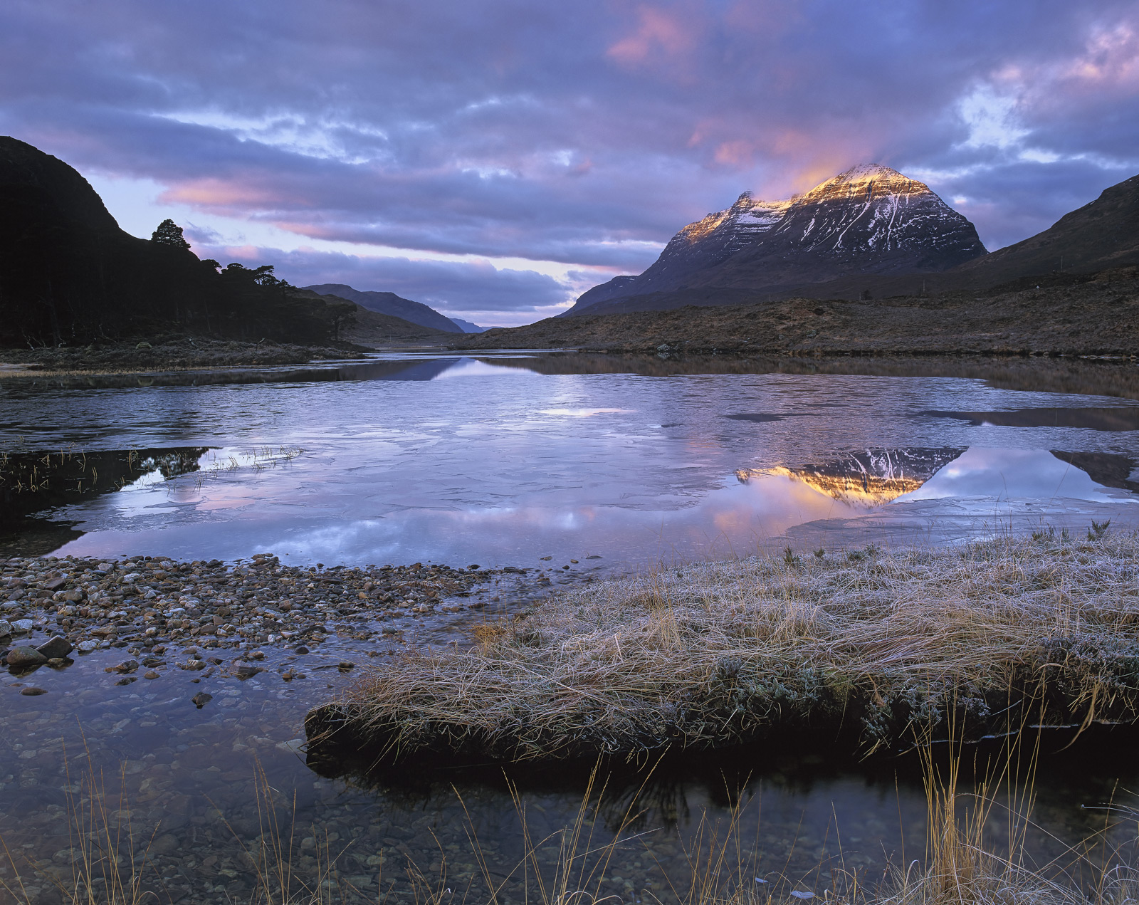 It was not a particularly promising morning standing around freezing various parts of my anatomy at Loch Clair with the ominous...