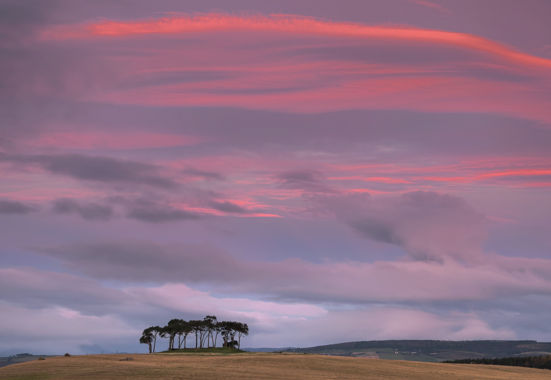 I had planned to capture a moonset through a pink sky on a specific time of year where a full moon would set behind the scots...