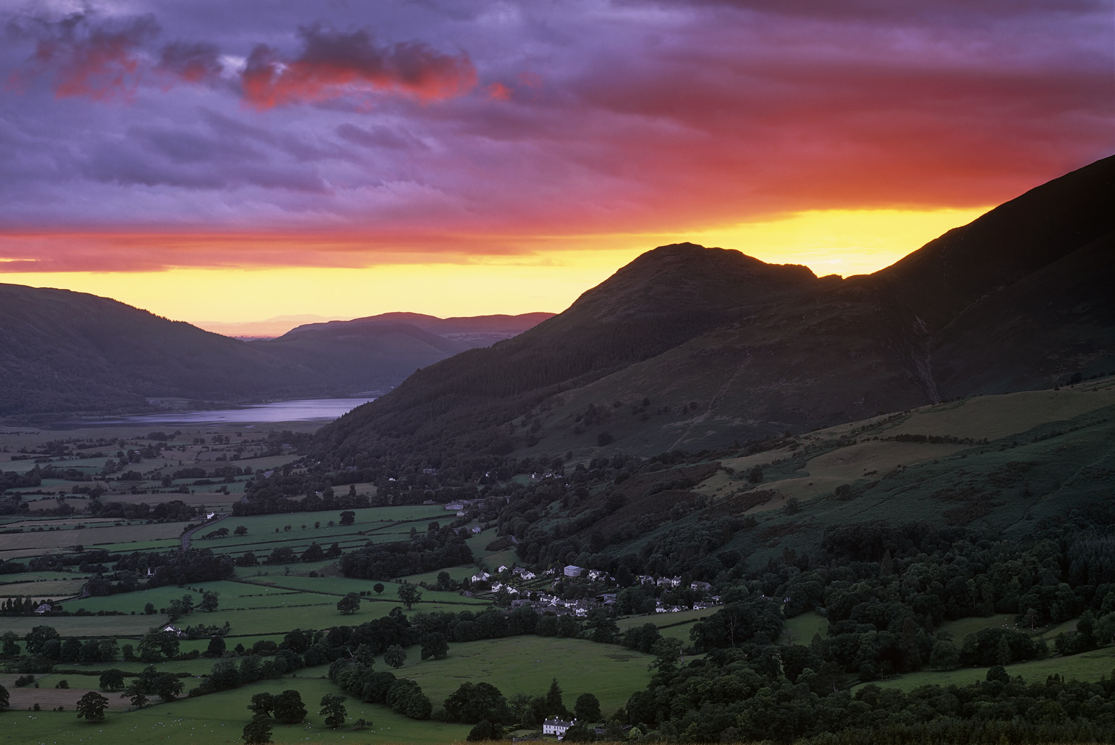 Whilst standing on the summit ofLatrigg Fell in mid summer looking iout over Derwent Water and the town of Keswick far...