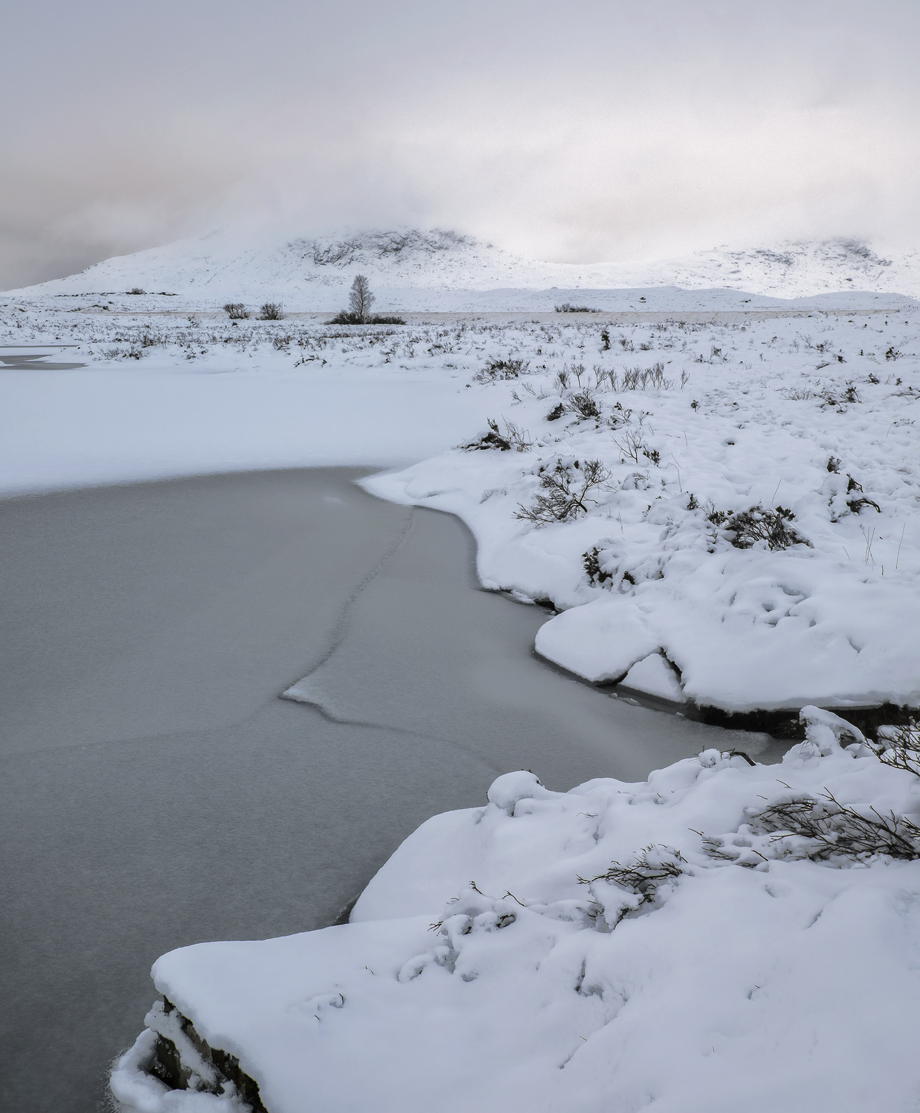 Having stomped out across a snow covered wasteland adjacent to Loch Ba, I found myself in a snowy desert of almost featureless...