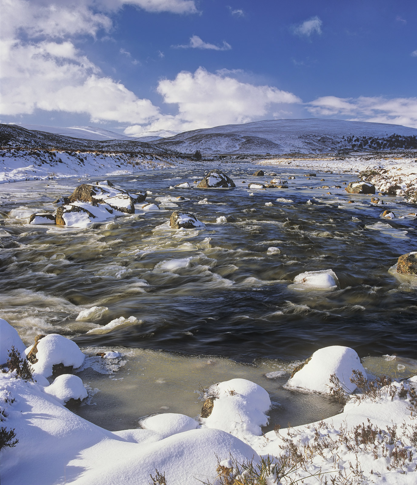 The river that drains from Glascarnoch reservoir flows down the river Garve across a high moorland. The stream is a rough...