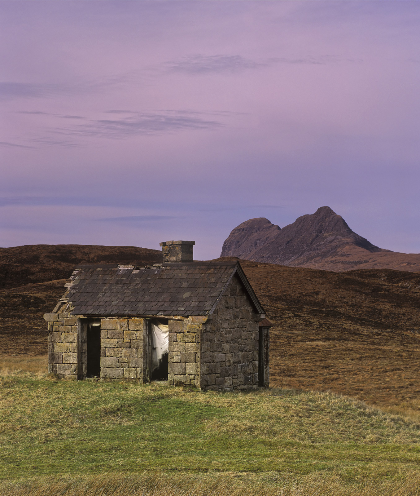 In Tatters, Elphin, Assynt, Scotland, stone, bothy, grass, mound, road, character, Cul Mor, Suilven, curtains, plum, sky, photo