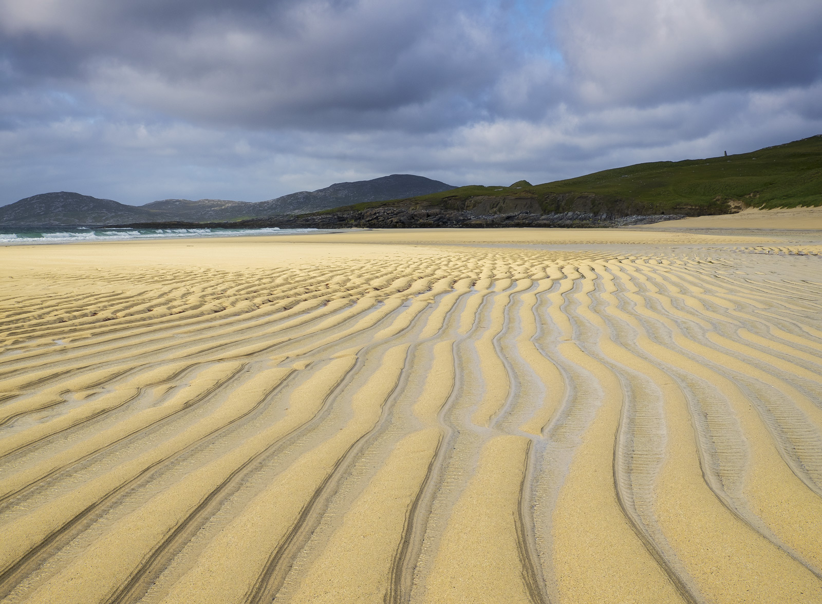 A coarse grain sand beach like the ones found on Harris's west coast tend to form substantial grooves when the tide pulls out...