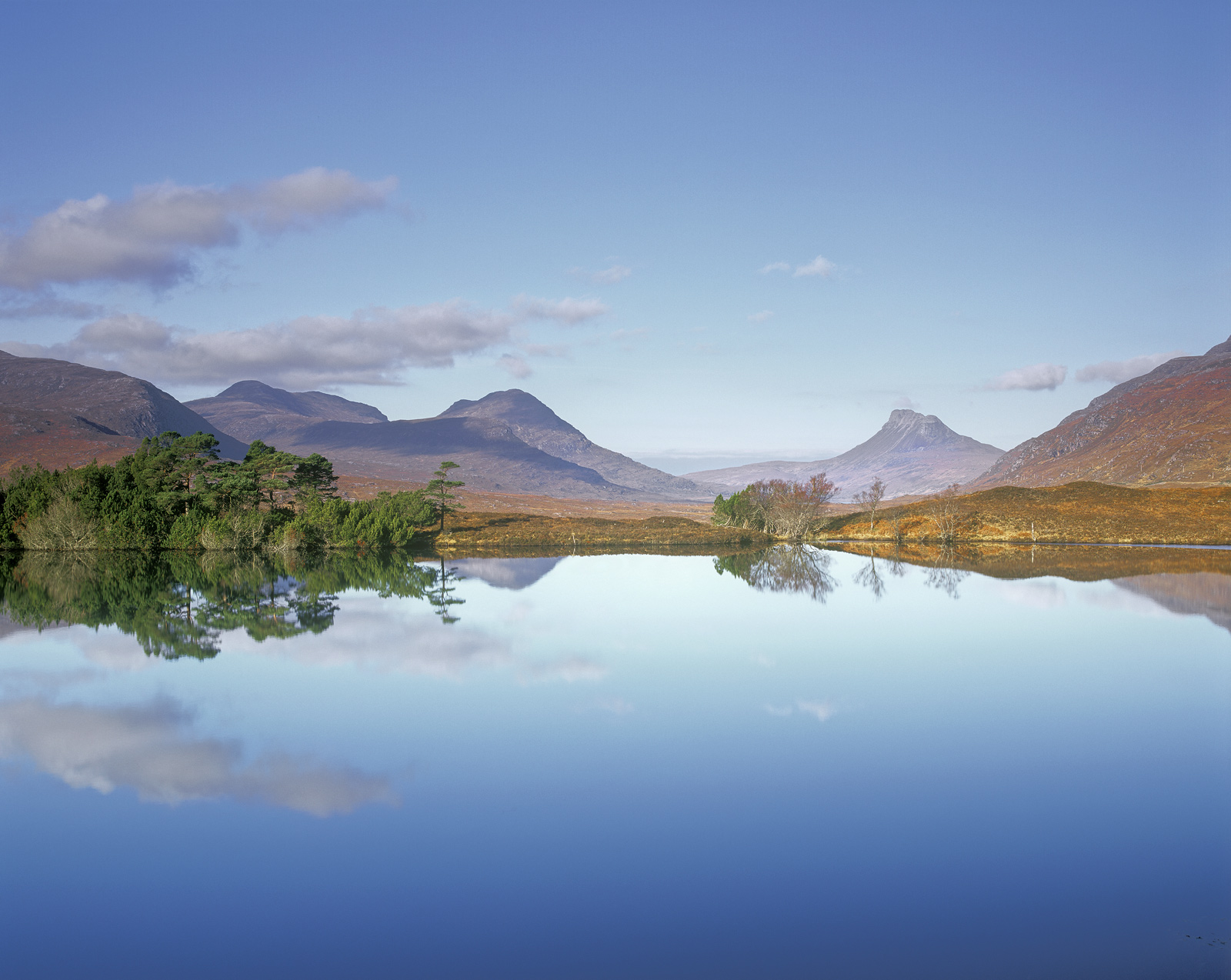A perfectly still and silent autumnal morning with Stac Pollaidh, Cul Mor,Ben More Coigachand the other mountains...