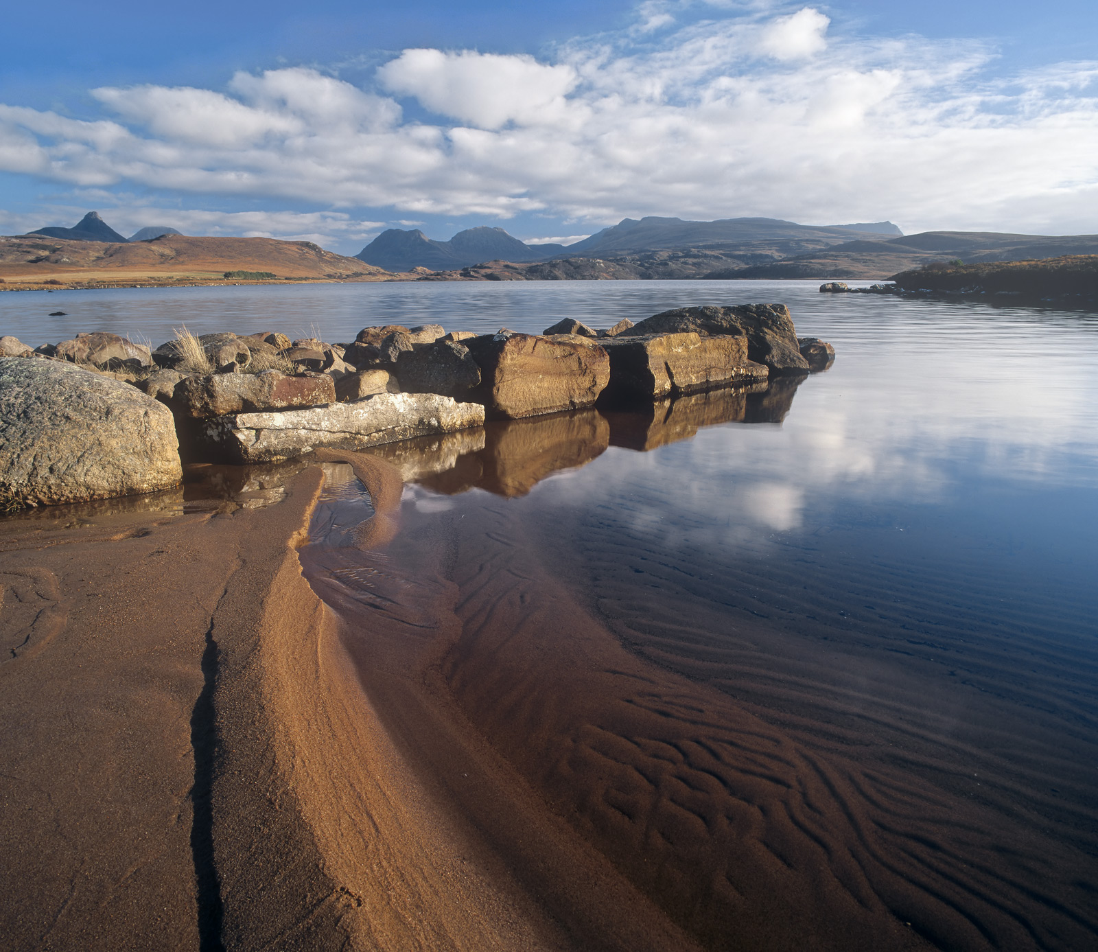 The western end of Loch Osgaig has a little tin boat shed and one or two moored fishing boats beside this tiny little fresh water...