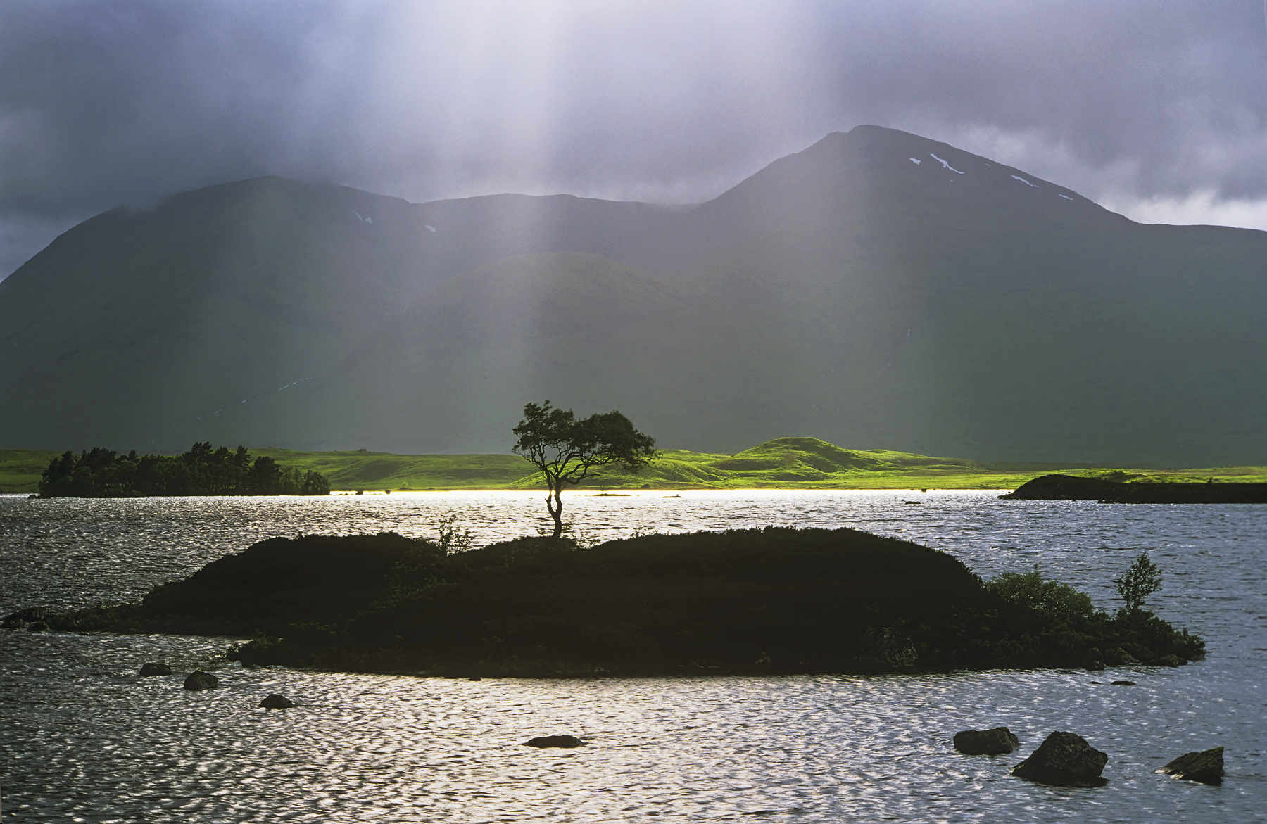 Crespecular rays shine from around the edges of clouds and I hoped I would get the chance to photograph the little island tree...