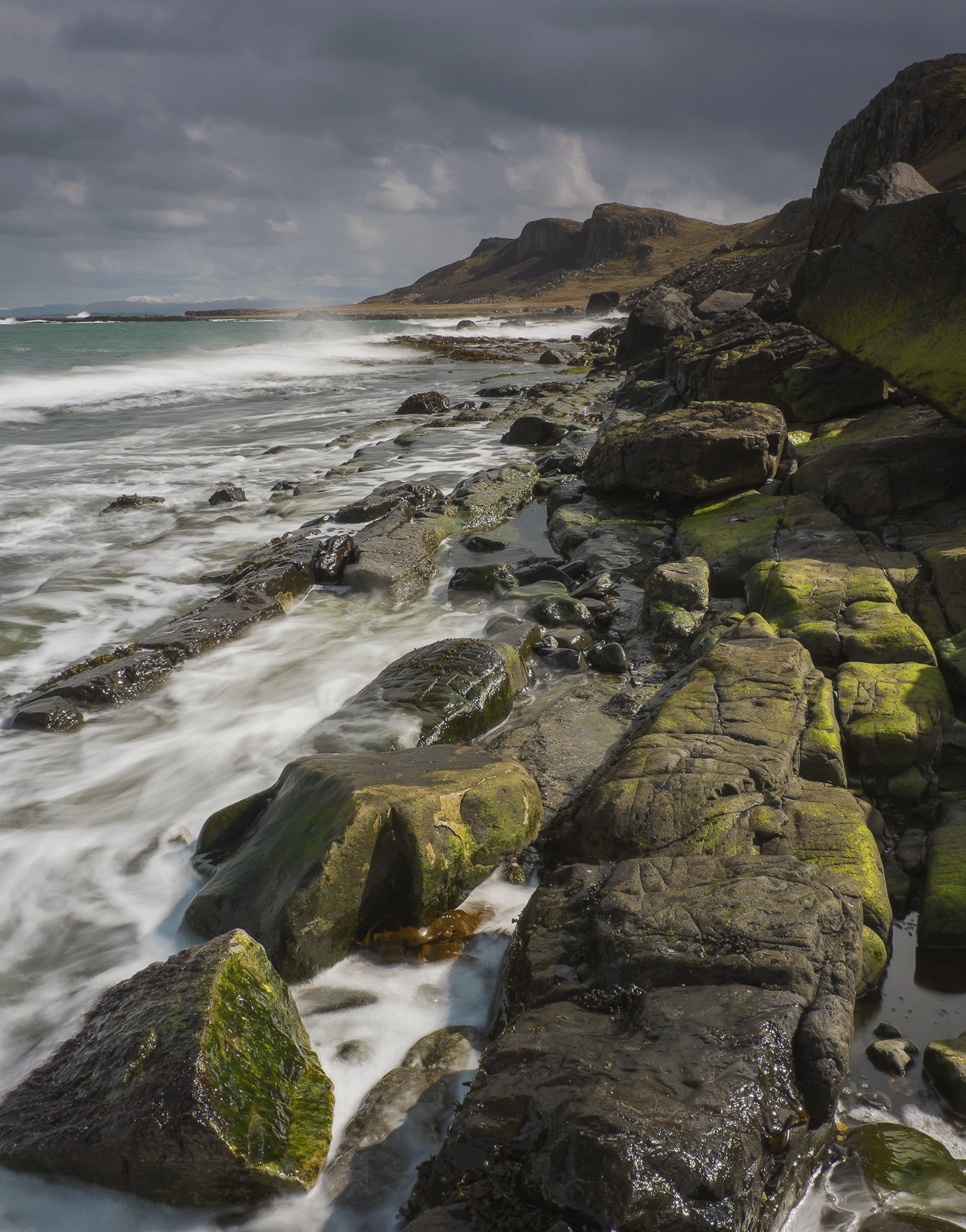 Staffin Bay is quite a strange place. The coast is rocky and rough the cliffs fluted like the pleats on a gigantic kilt...