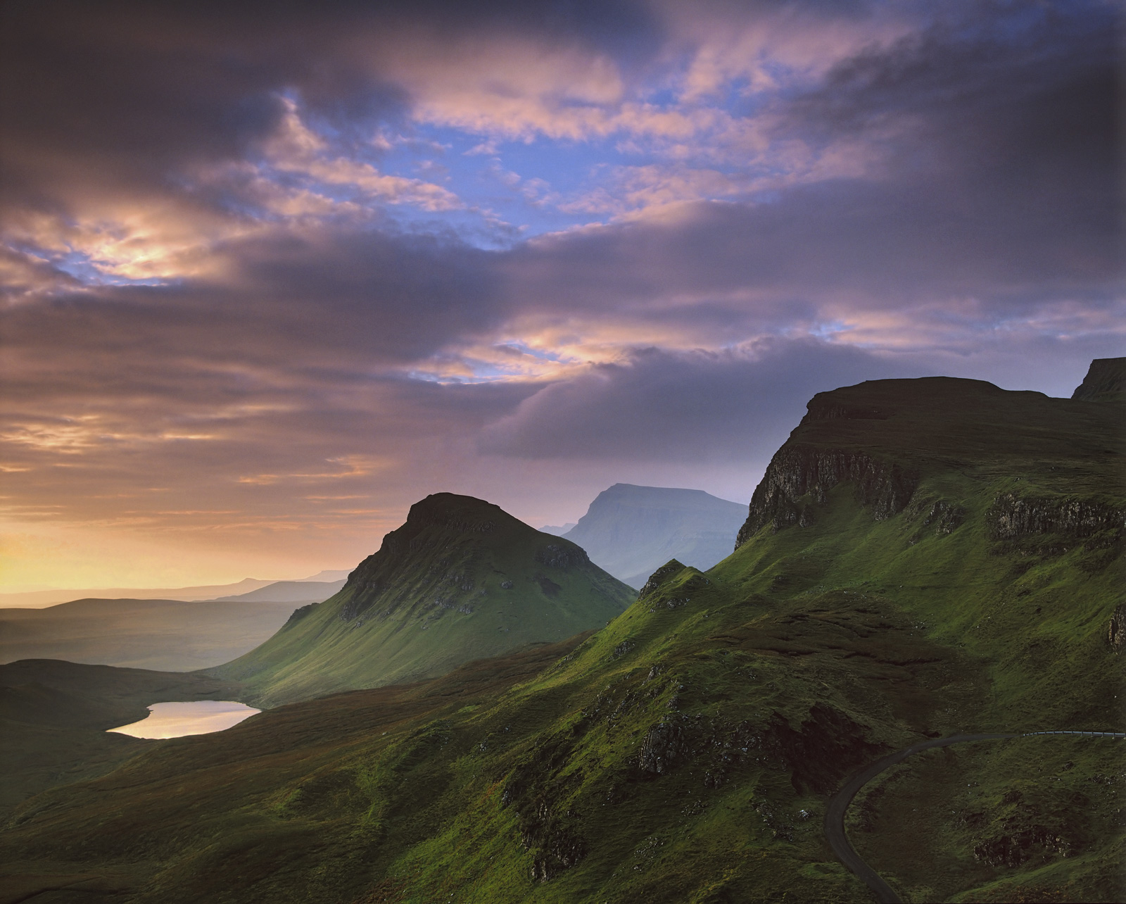 Honey light from a breaking dawn washes over the velvet slopes of the Quiraing painting the under belly of the clouds and duly...