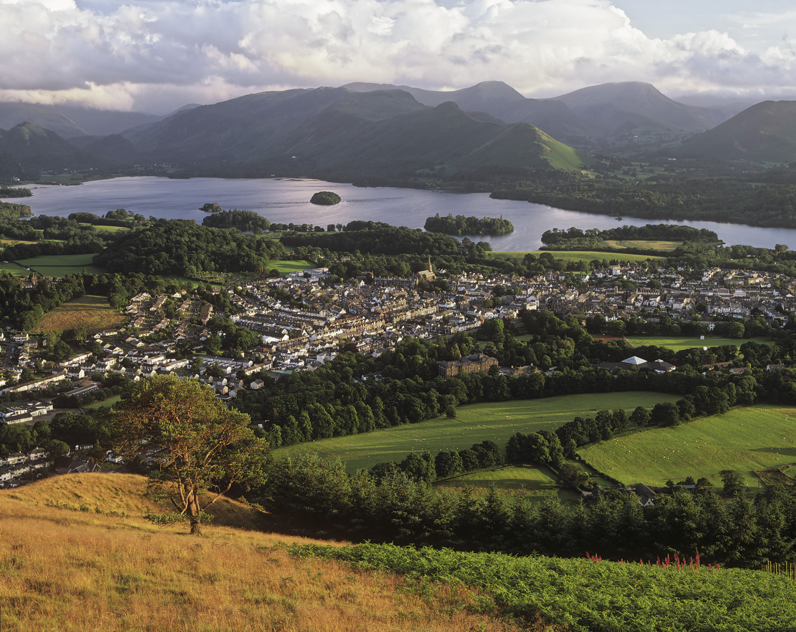 The Lake District town of Keswick sprawled out like a map in front of Derwent water below Latrigg Fell and the distant Cats Bells...