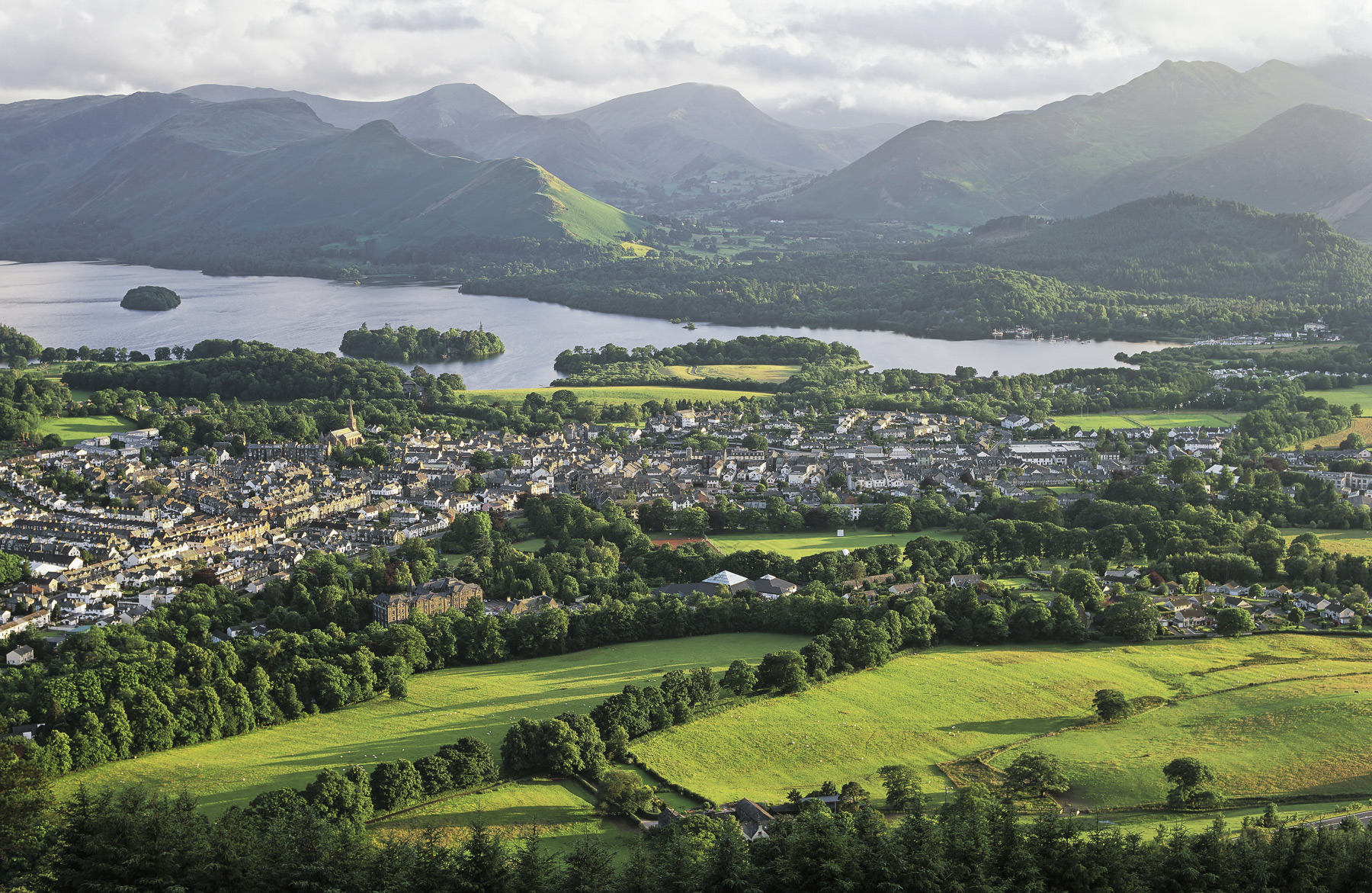 One of the best views of the Lake District town of Keswick and its nearby lake, Derwent backed by the green and verdant slopes...