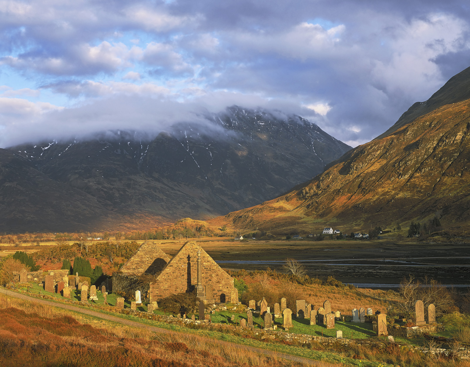 Nestled in a crook of Loch Duich near the tiny coastal village of Kintail is an old cemetry with a staggering view of the Five...