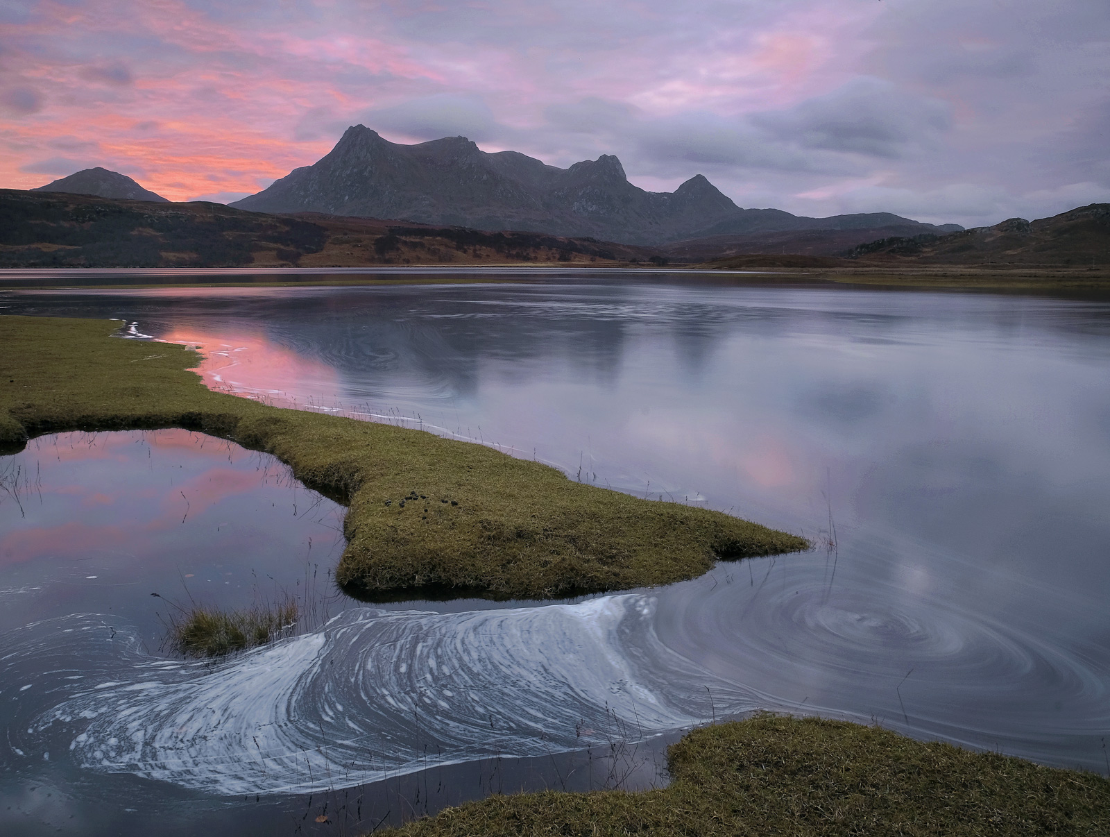 Ben Loyal is silently reflected in the Kyle of Tongue's estuary in the pre-dawn pink twilight glow. It is just about high...