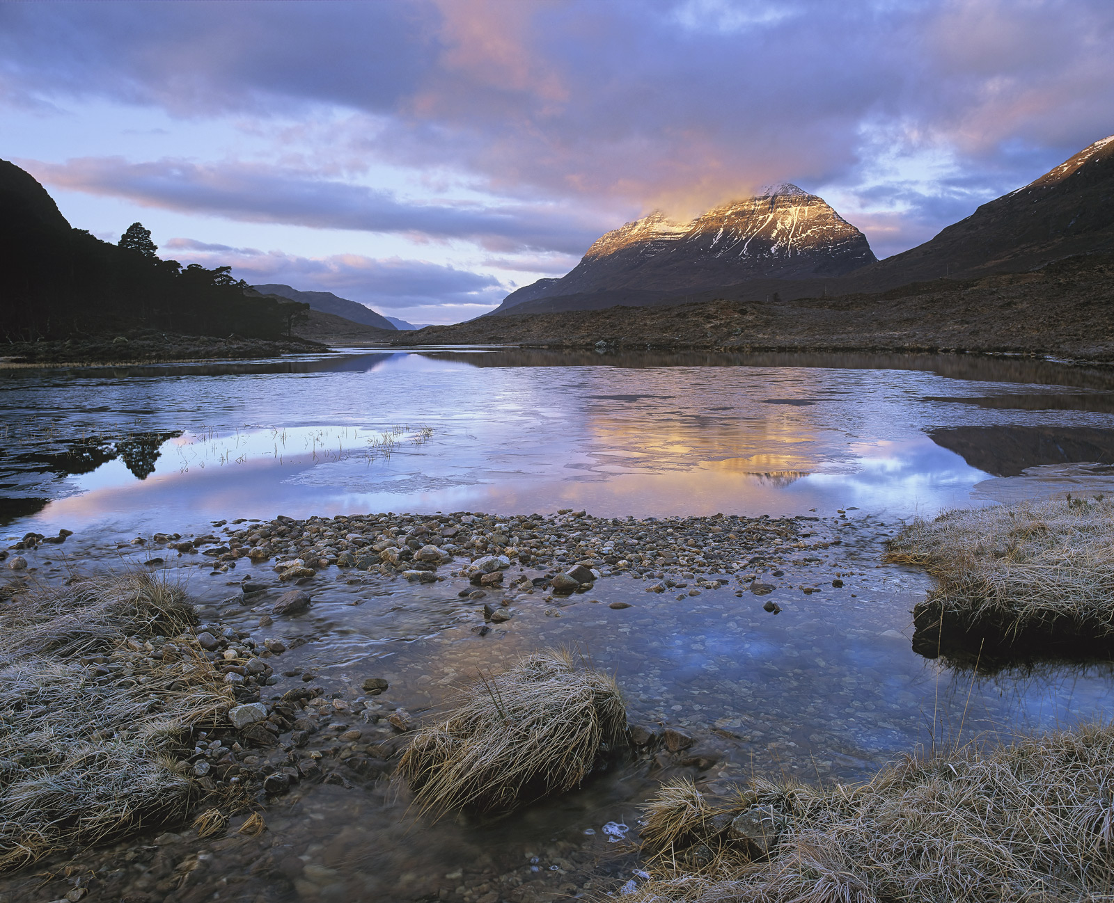 Winter mornings at the edge of Loch Clair can on occasions prove amazingly photogenic this proved to be one such dawn with a...