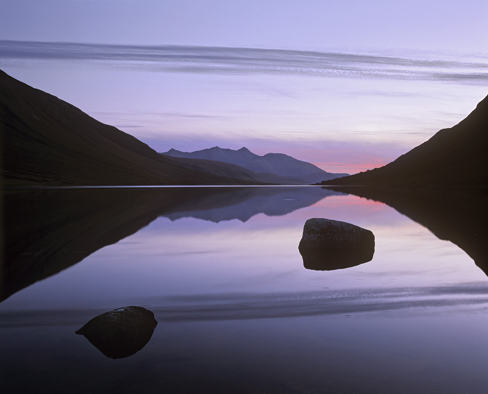 A stunning mirror smooth reflection on a sea loch is quite a rare event but Loch Etive benefits from being sheltered on both...