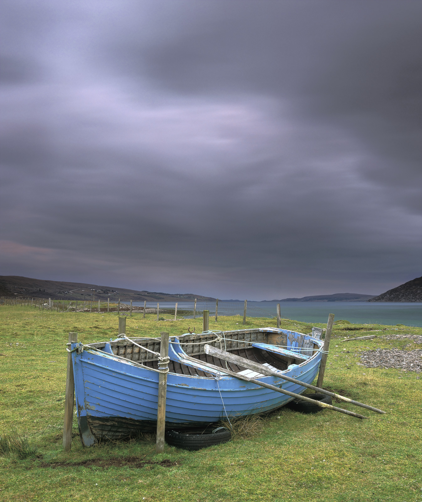 This little blue boat has been tied up out here for a good long while I suppose it will be refloated again in the summertime...