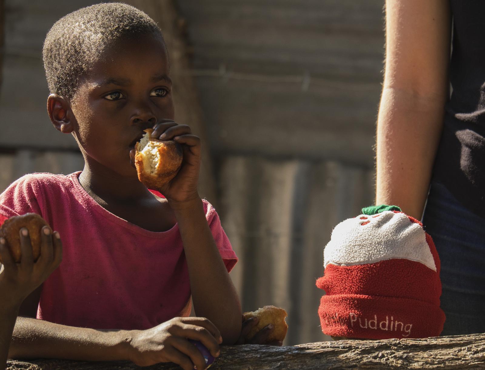 Little Pudden, Okavango Delta, Botswana, Africa, walk, village, group, kids, tin, shack, home, doughnuts, hat  , photo