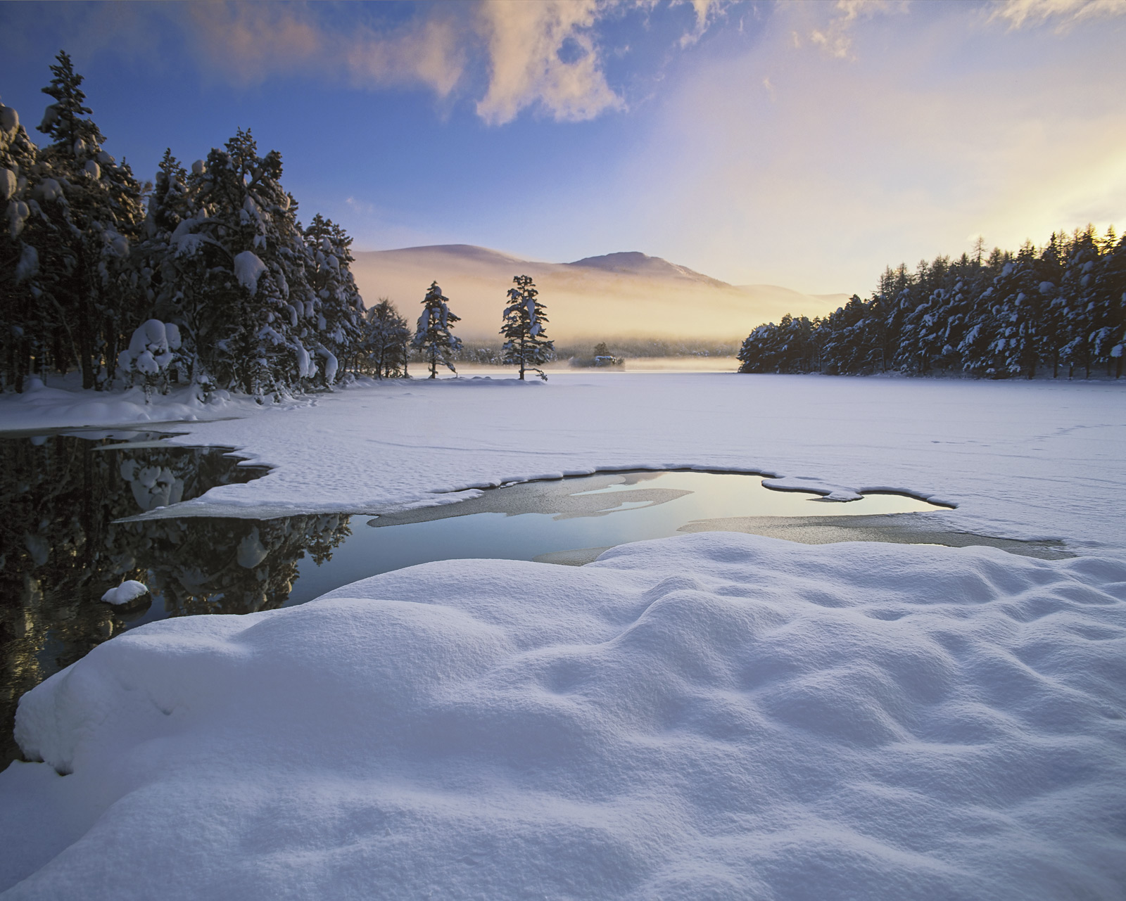 Pillows of soft deep white snow, unblemished perfection stretches out across the near frozen surface of Loch An Eilein it's ruined...
