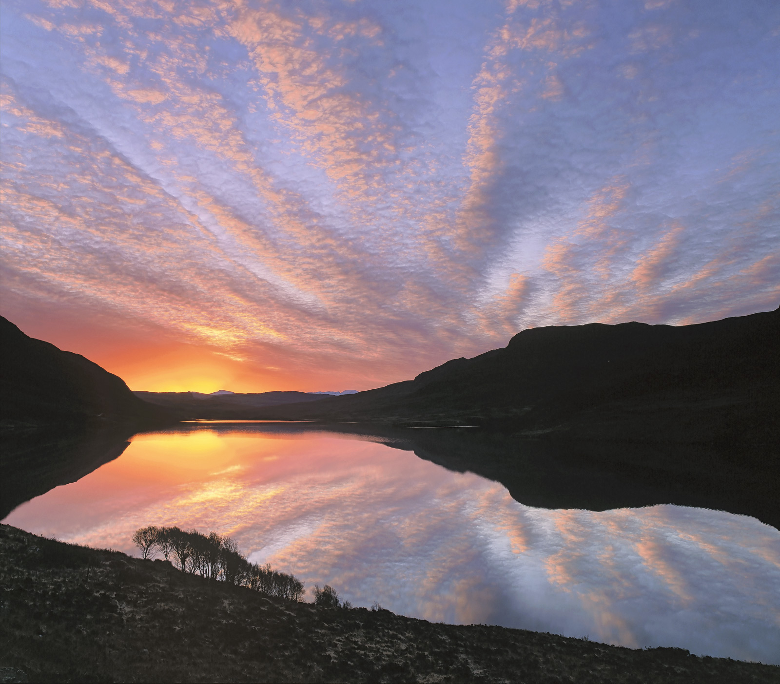 This is actually the most outrageously gorgeous sunrise at Inverpolly I have ever seen and I have been there a lot. Not...