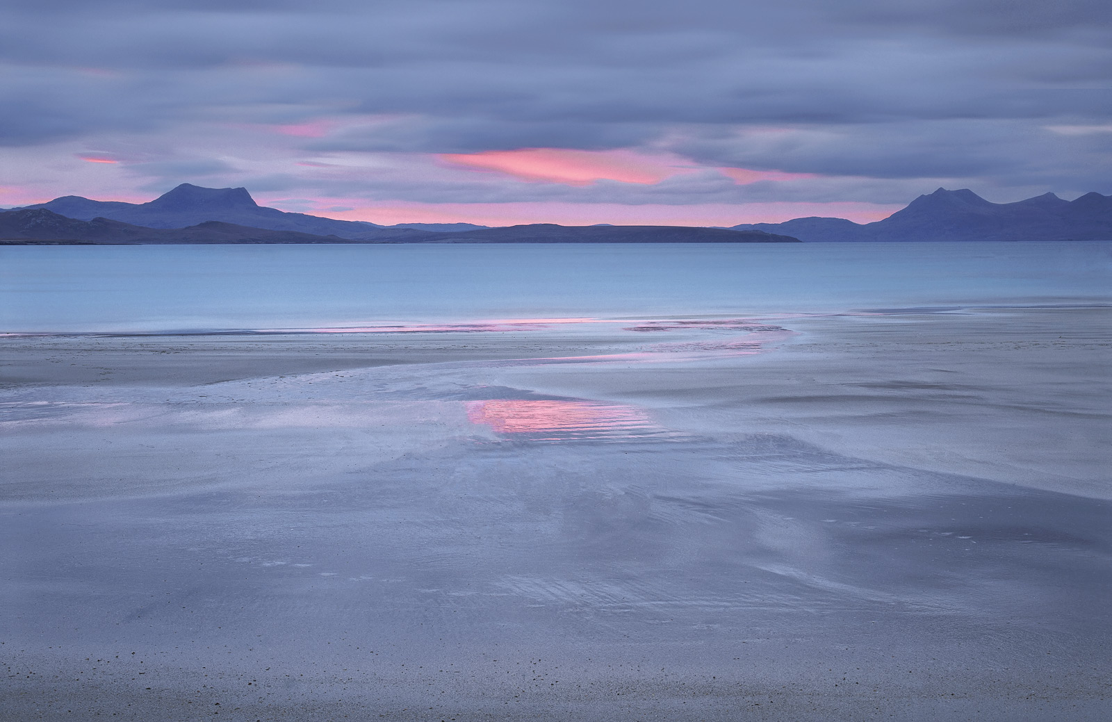 Another visit to my favourite west coast beach this time in winter about a half hour before sunrise. A pink glow broke...