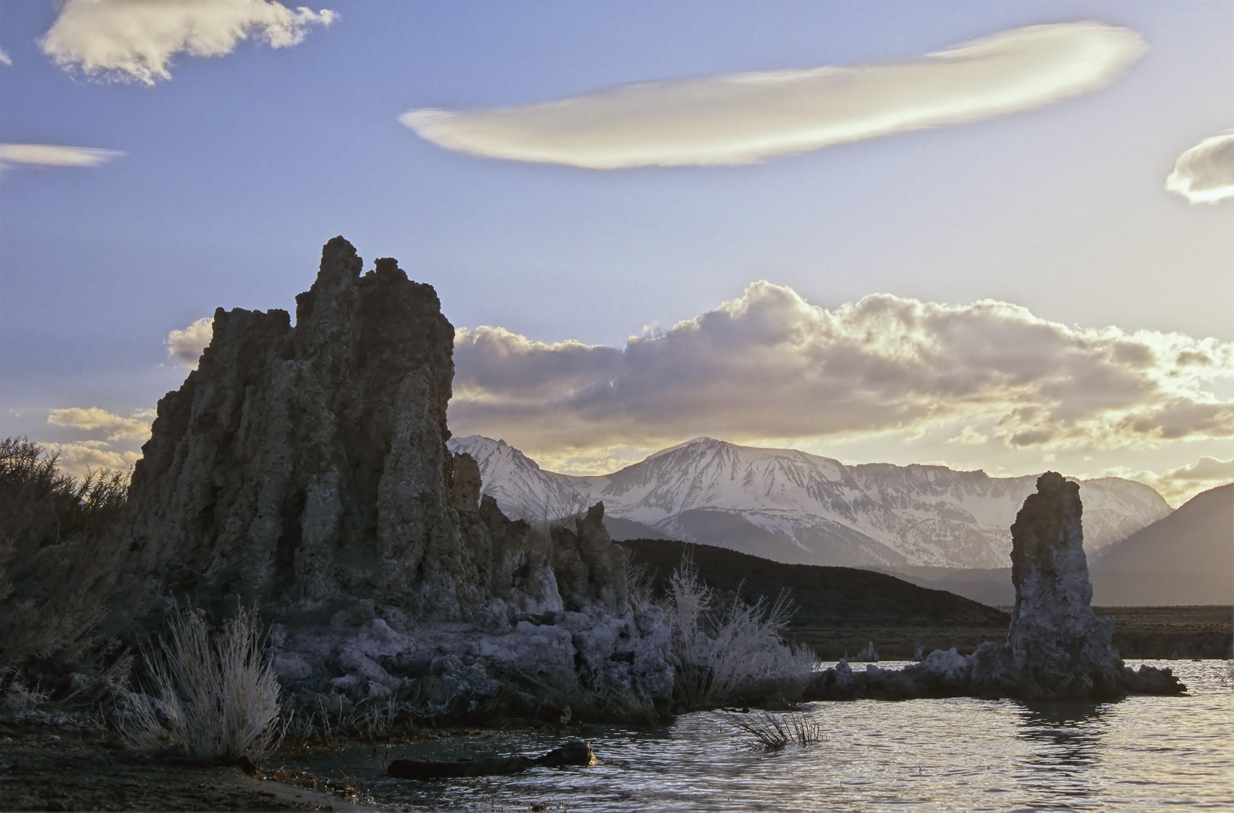calcite towers known as tufas generated from the extremely high mineral content of Mono Lake festoon the borders creating an...