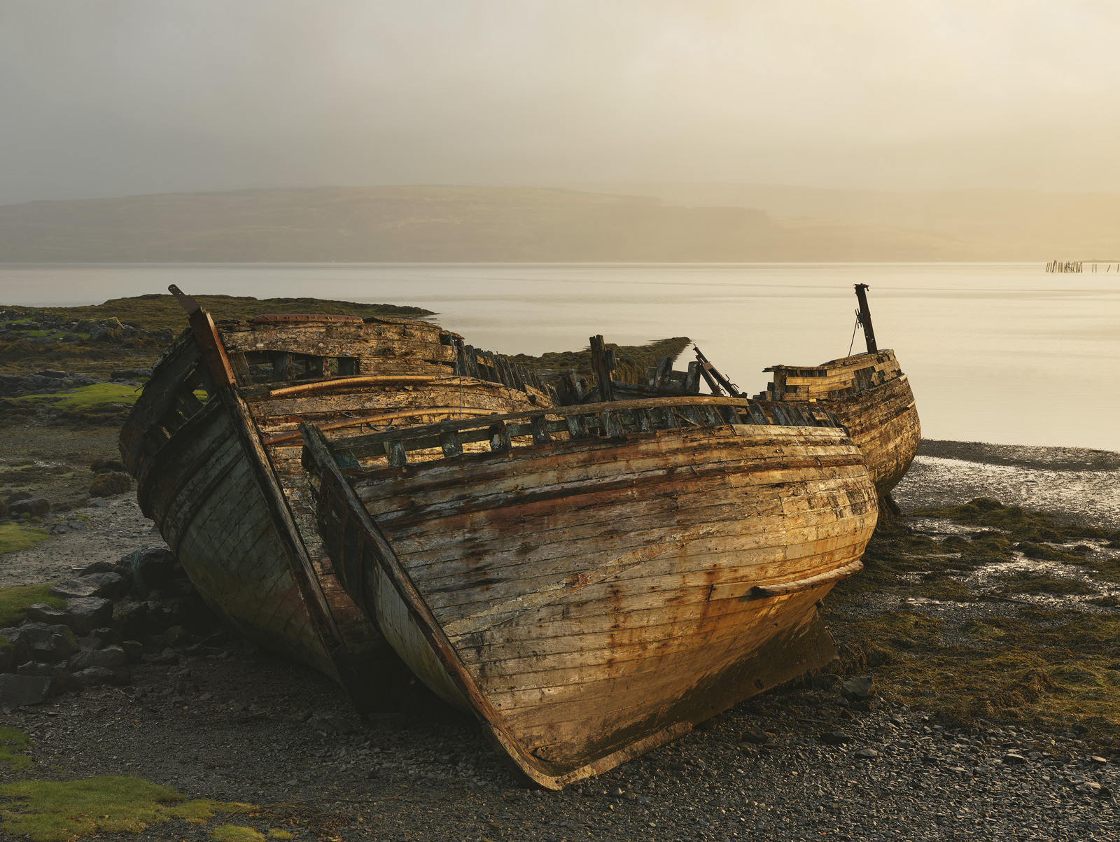 Monsoon and Sunshine Salen, Salen, Mull, Scotland squally, backlit, shower, soaked, rain, sunlight, wrecked, boats, old, photo