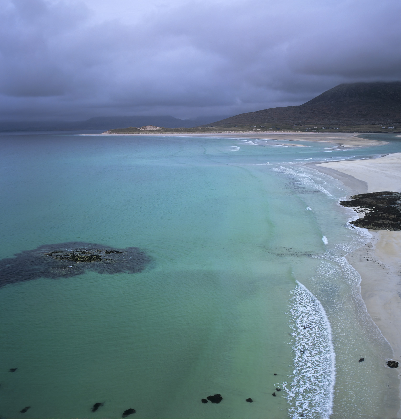 Returning from a trip to Traigh Mhor further along the west coast of Harris the vehicle summited the overlook we were greeted...
